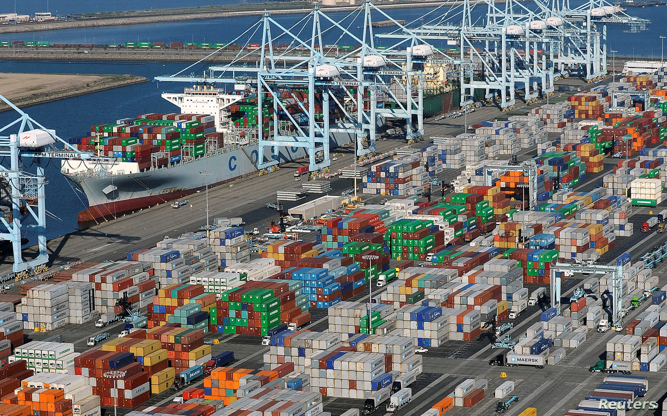 FILE - Shipping containers sit at the ports of Los Angeles and Long Beach, Calif., in this aerial photo, Feb. 6, 2015. China is the largest trading partner for both ports.