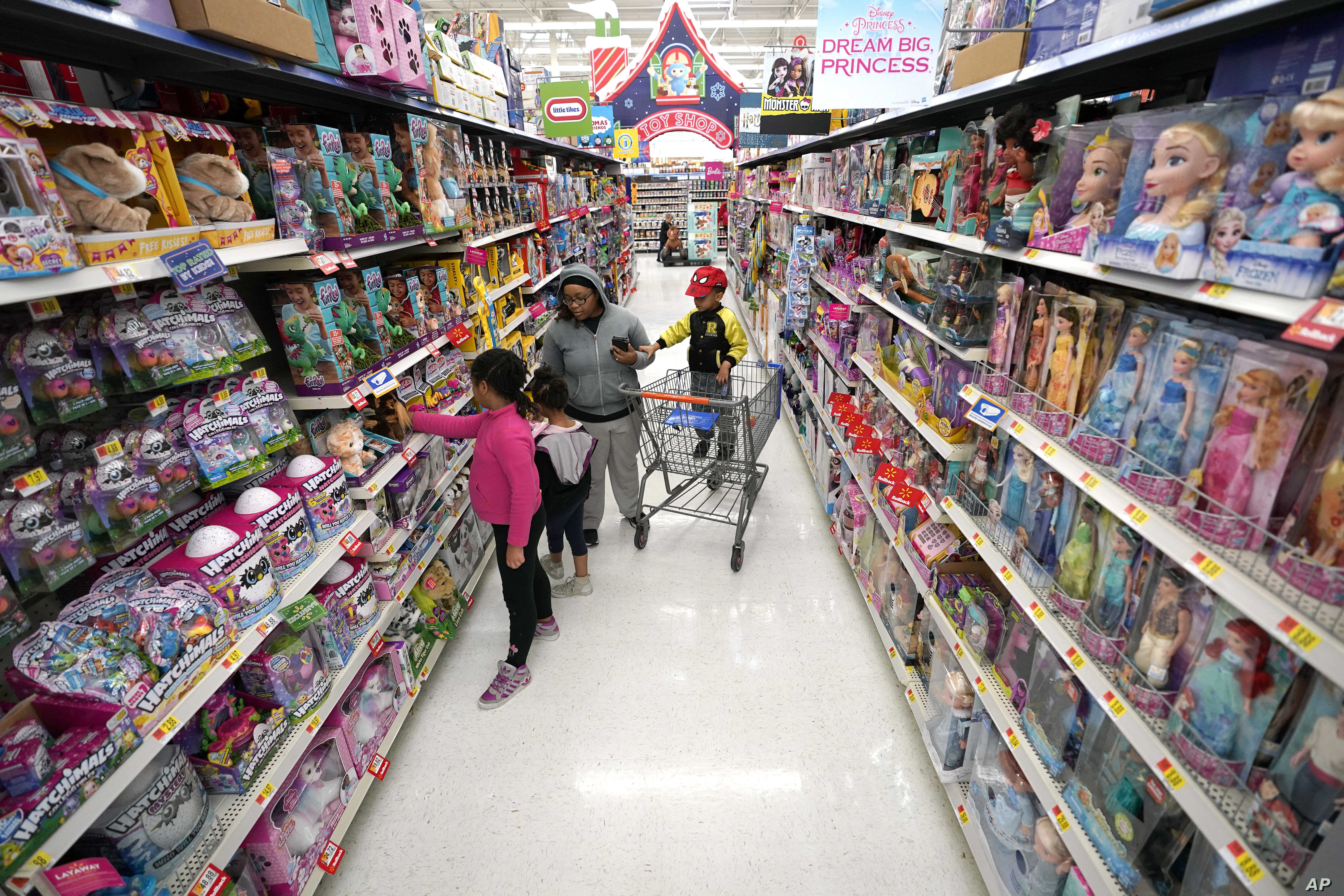 Shoppers look at toys at a Walmart Supercenter in Houston, Texas on Nov. 9, 2018.