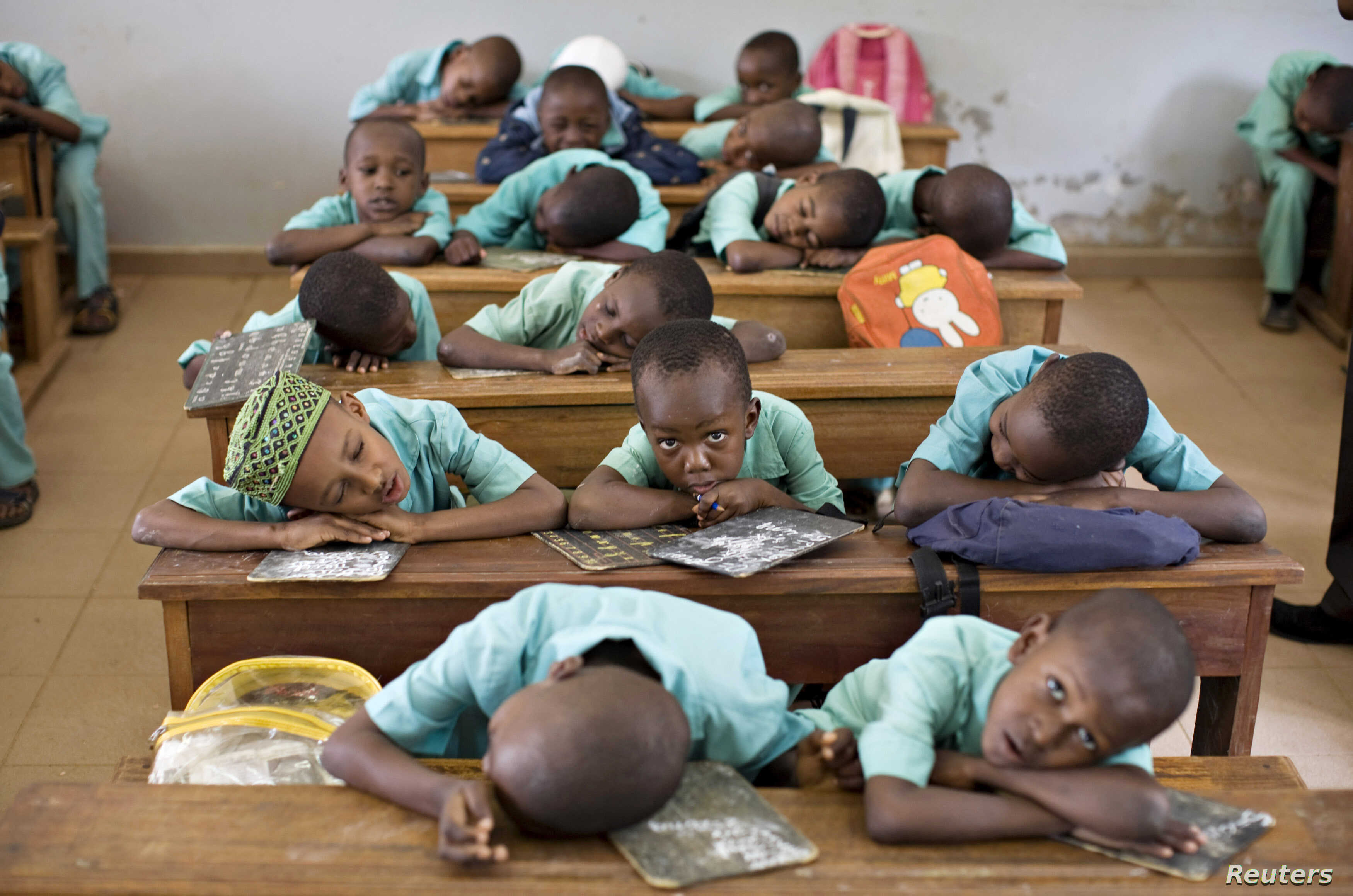 FILE -- Muslim boys rest their heads on their desks during a language class at Al-Haramain madrassa at the Islamic Complex in Cameroon's capital Yaounde. Teachers, especially in the north, are afraid to return to their classrooms, because of Boko Ha...
