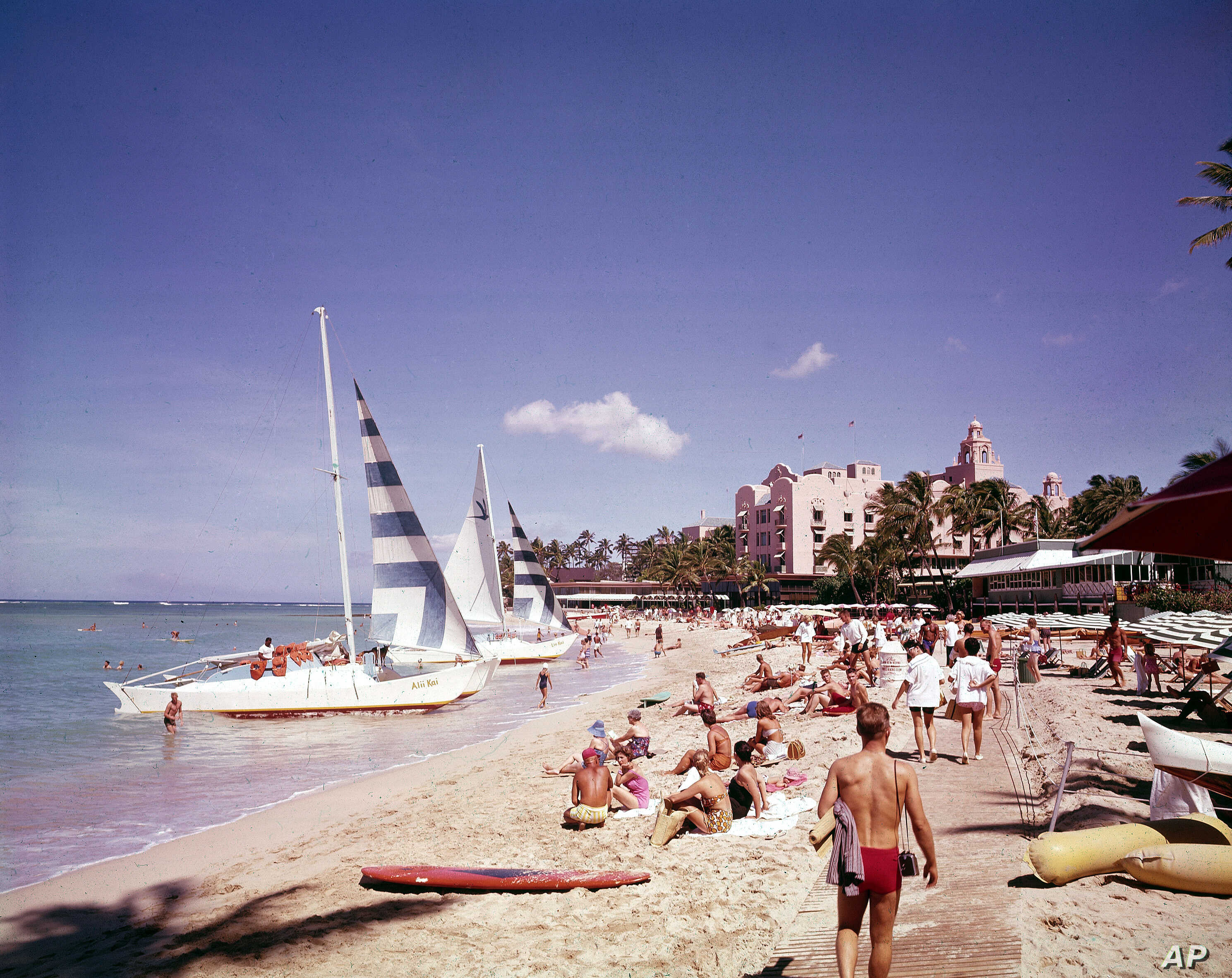 Waikiki beach, Hawaii, in July 1961. Post WWII settlement and tourism led to a boom in housing developments and hotels, leading to more land struggles with Native Hawaiians.