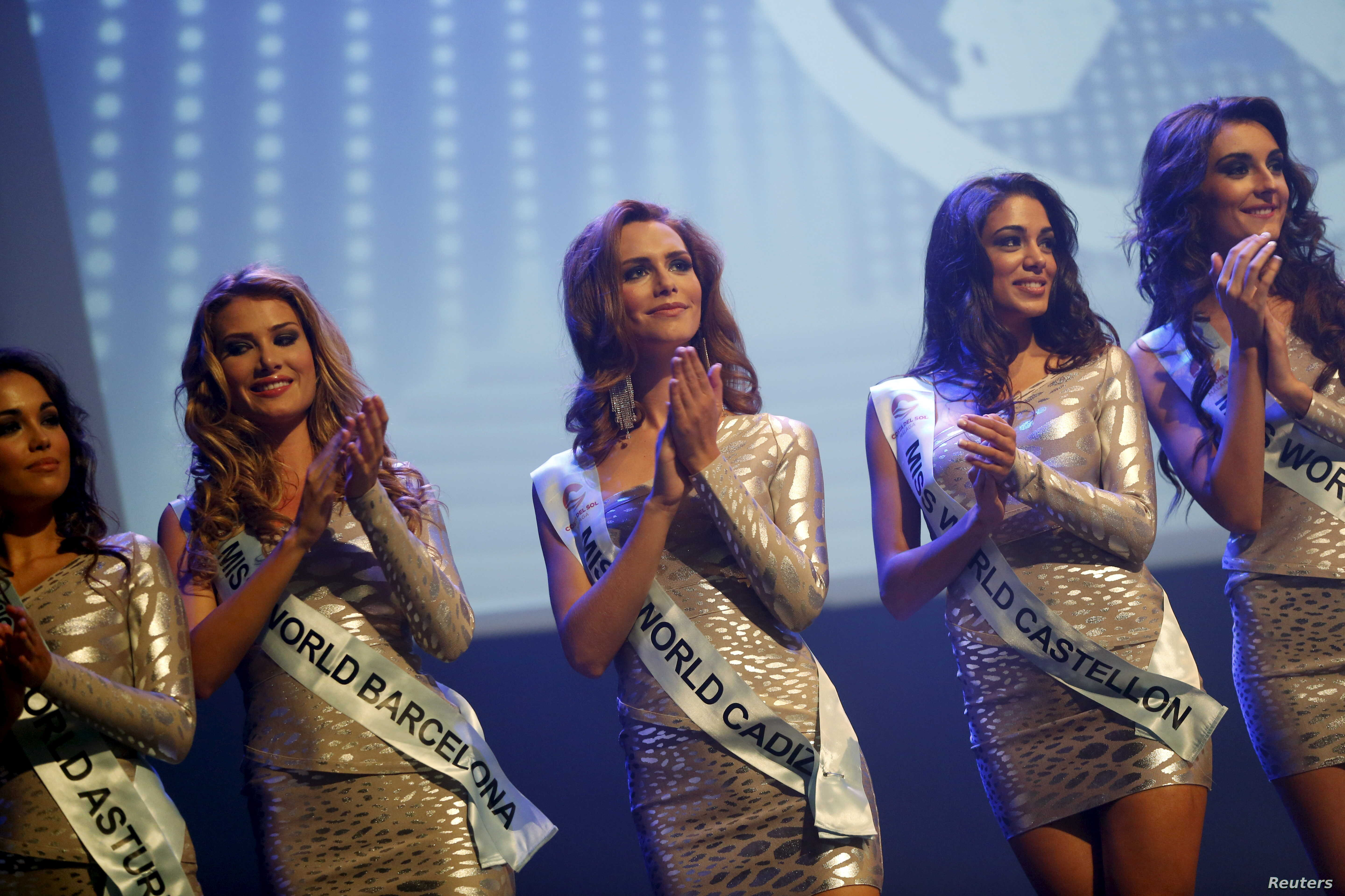 FILE - Angela Ponce, 24, center, competes in the Miss World Spain pageant in Estepona, southern Spain, Oct. 25, 2015. Ponce, the first openly transsexual woman to compete to represent Spain at the Miss World pageant, was eliminated in the first knock...