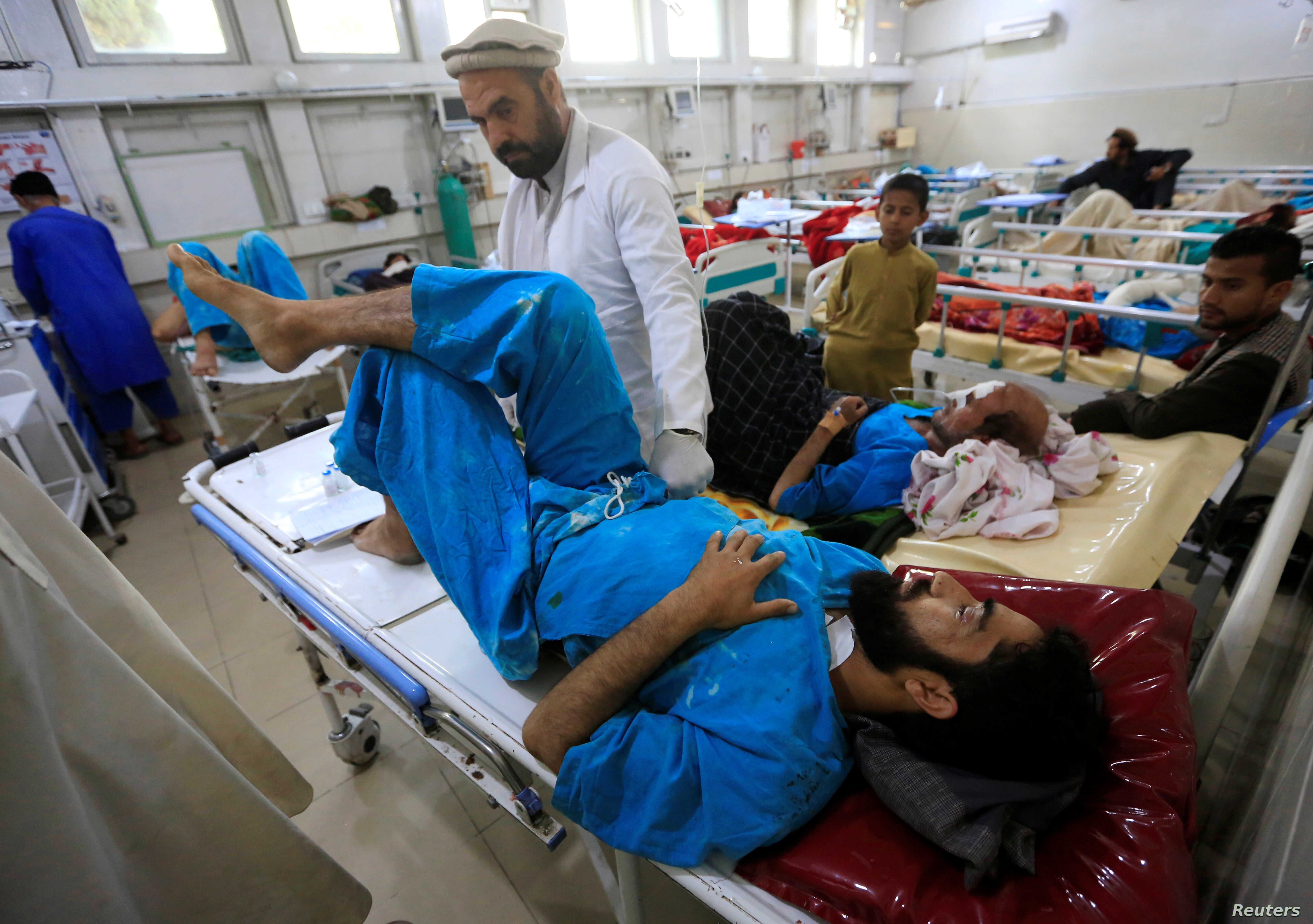 An injured man receives treatment in a hospital, after a blast in Jalalabad, Afghanistan, April 8, 2019.