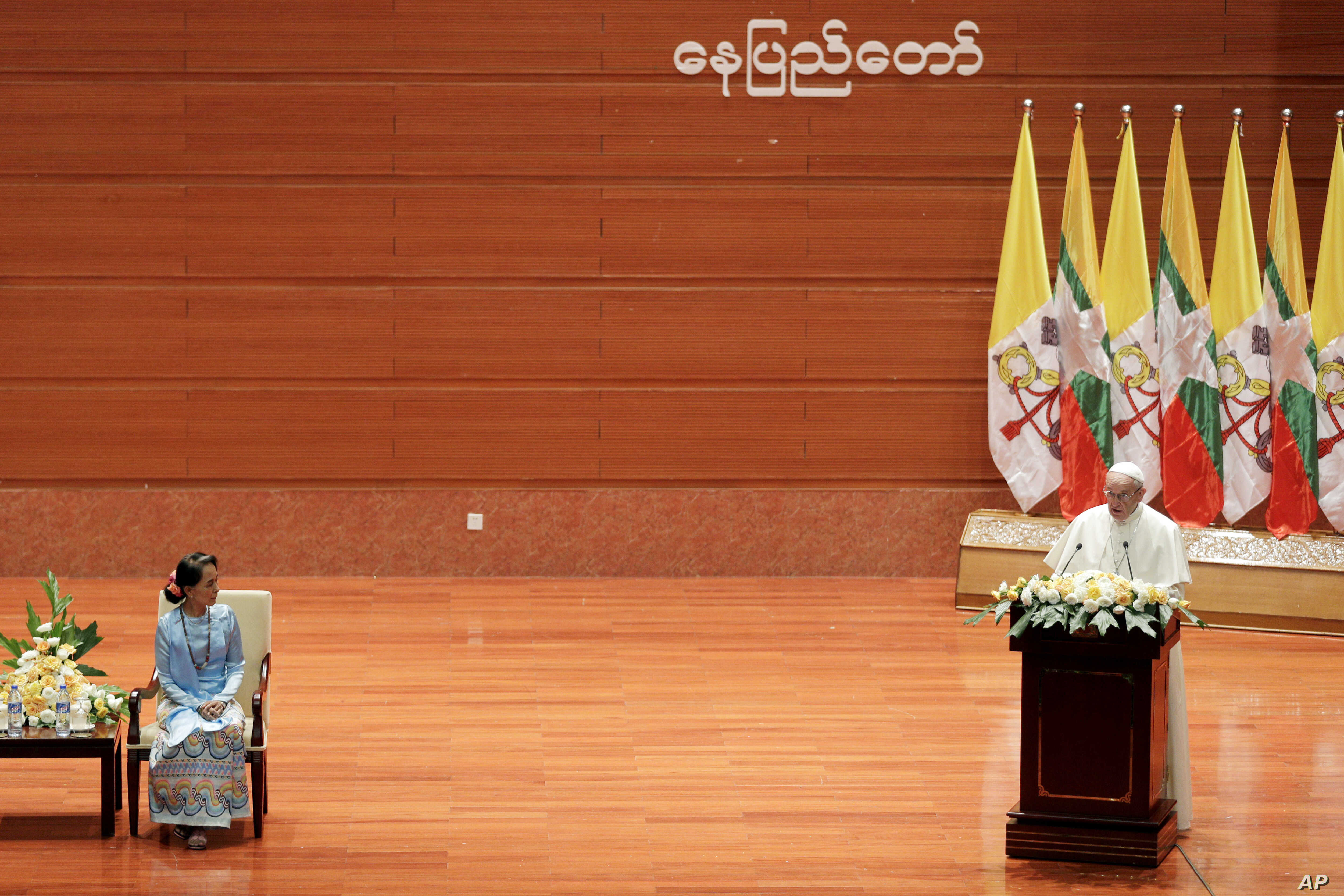 Myanmar's leader Aung San Suu Kyi, left, listens as Pope Francis delivers his speech at the International Convention Centre of Naypyitaw, Myanmar, Nov. 28, 2017.