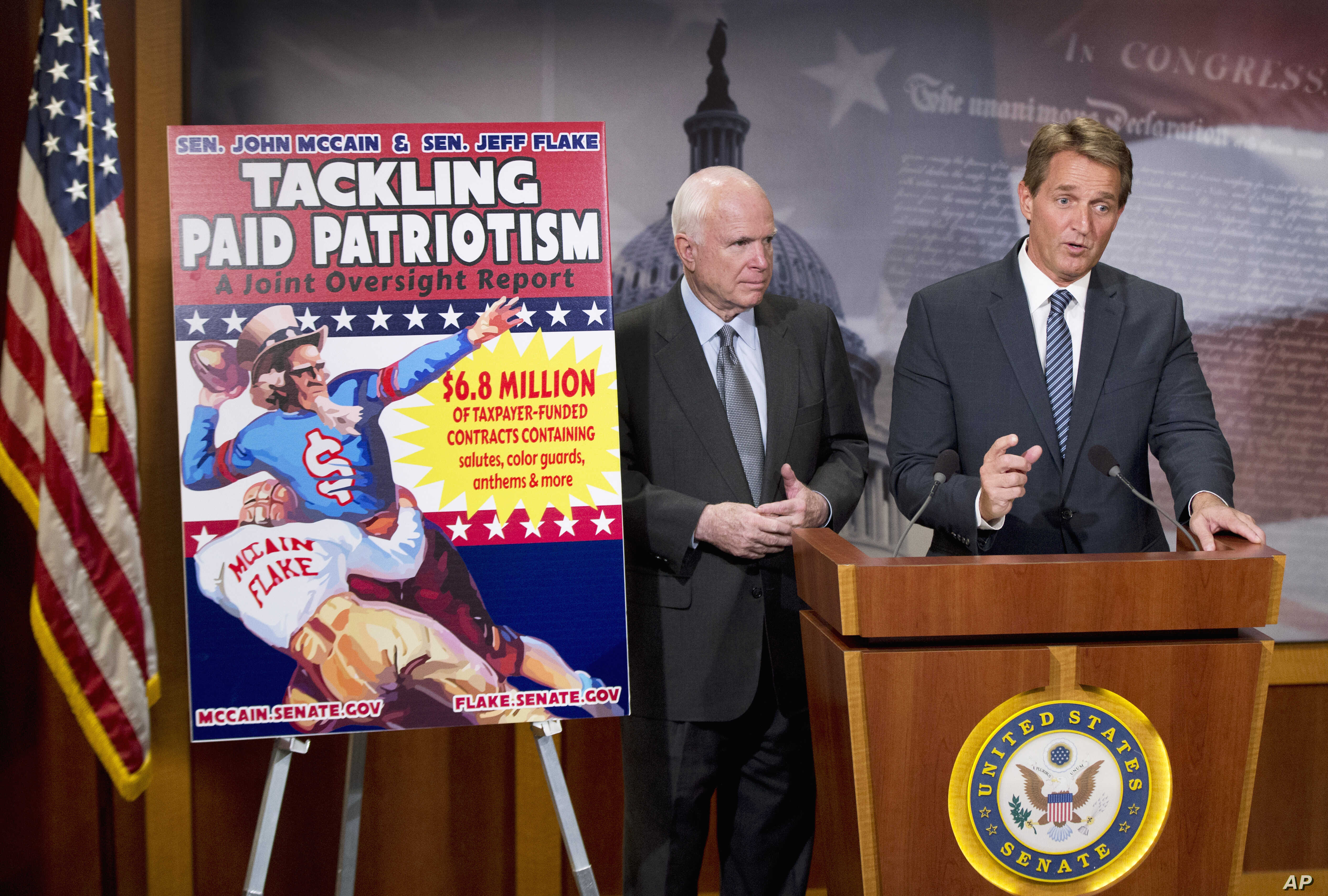 """Senators John McCain, left, and Jeff Flake talk to reporters about """"paid patriotism"""" during a news conference on Capitol Hill in Washington, Nov. 4, 2015."""