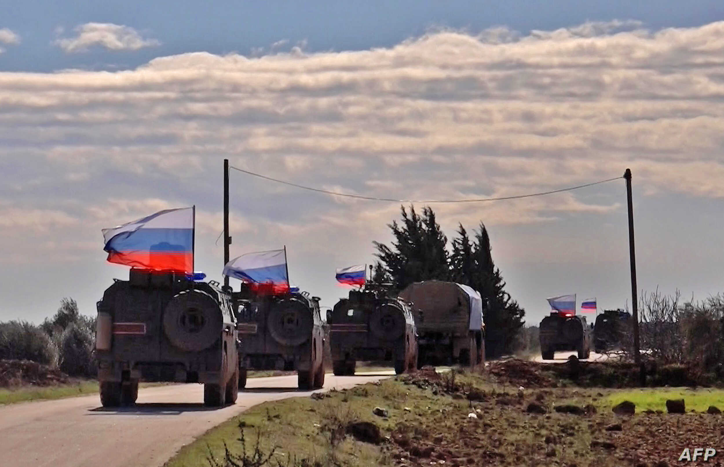 An image grab taken from AFP-TV on Jan. 17, 2019, shows Russian army vehicles on patrol in the area of Arimah, just west of Manbij, Syria, where a day earlier a suicide attack on a restaurant killed four U.S personnel.
