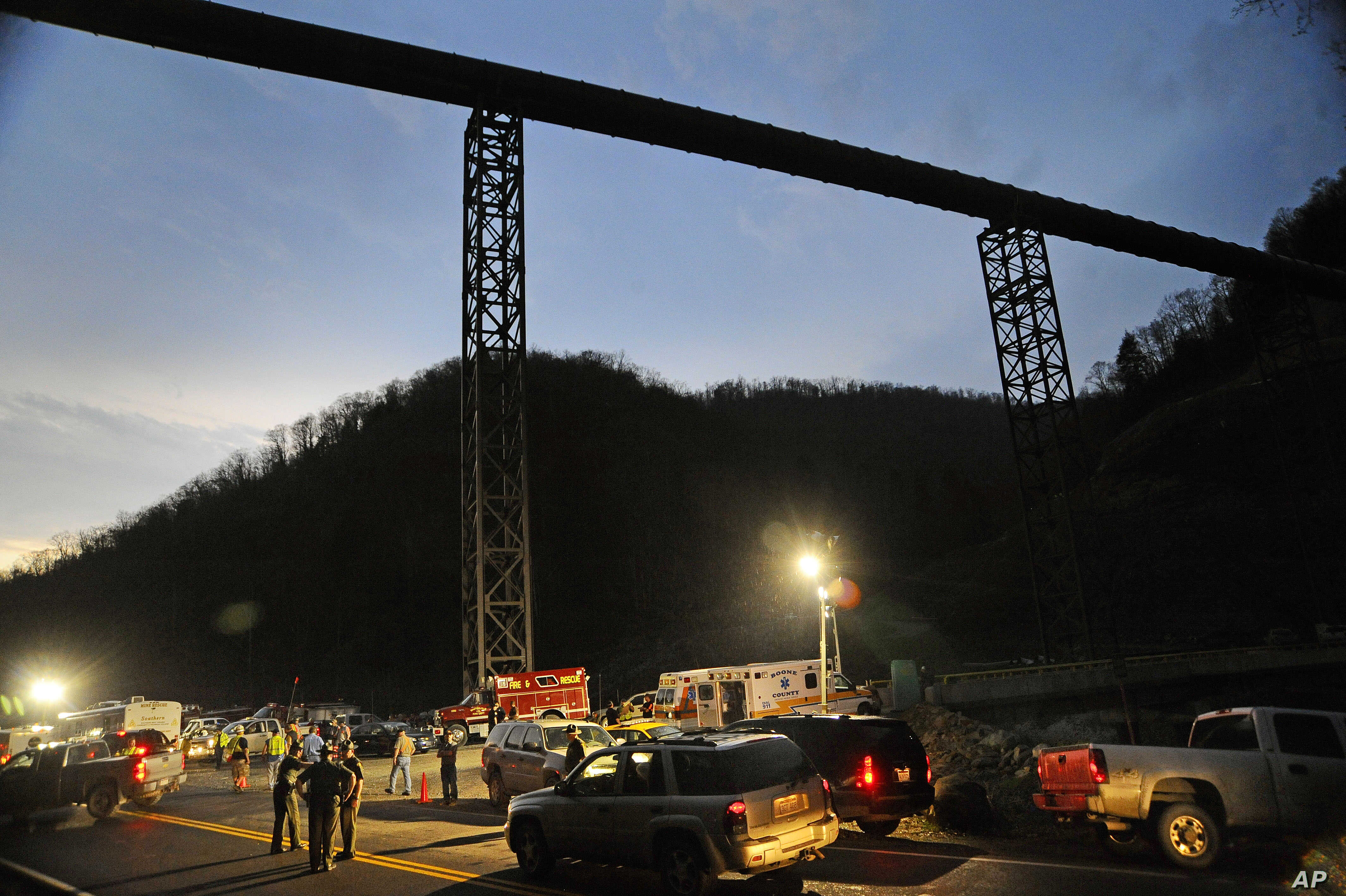 West Virginia State Police direct traffic at Massey Energy's Upper Big Branch Coal Mine in Montcoal, W.Va. 29 coal miners were killed in the April 2010 explosion, one of the worst mining disasters in the US. (AP Photo/Jeff Gentner)
