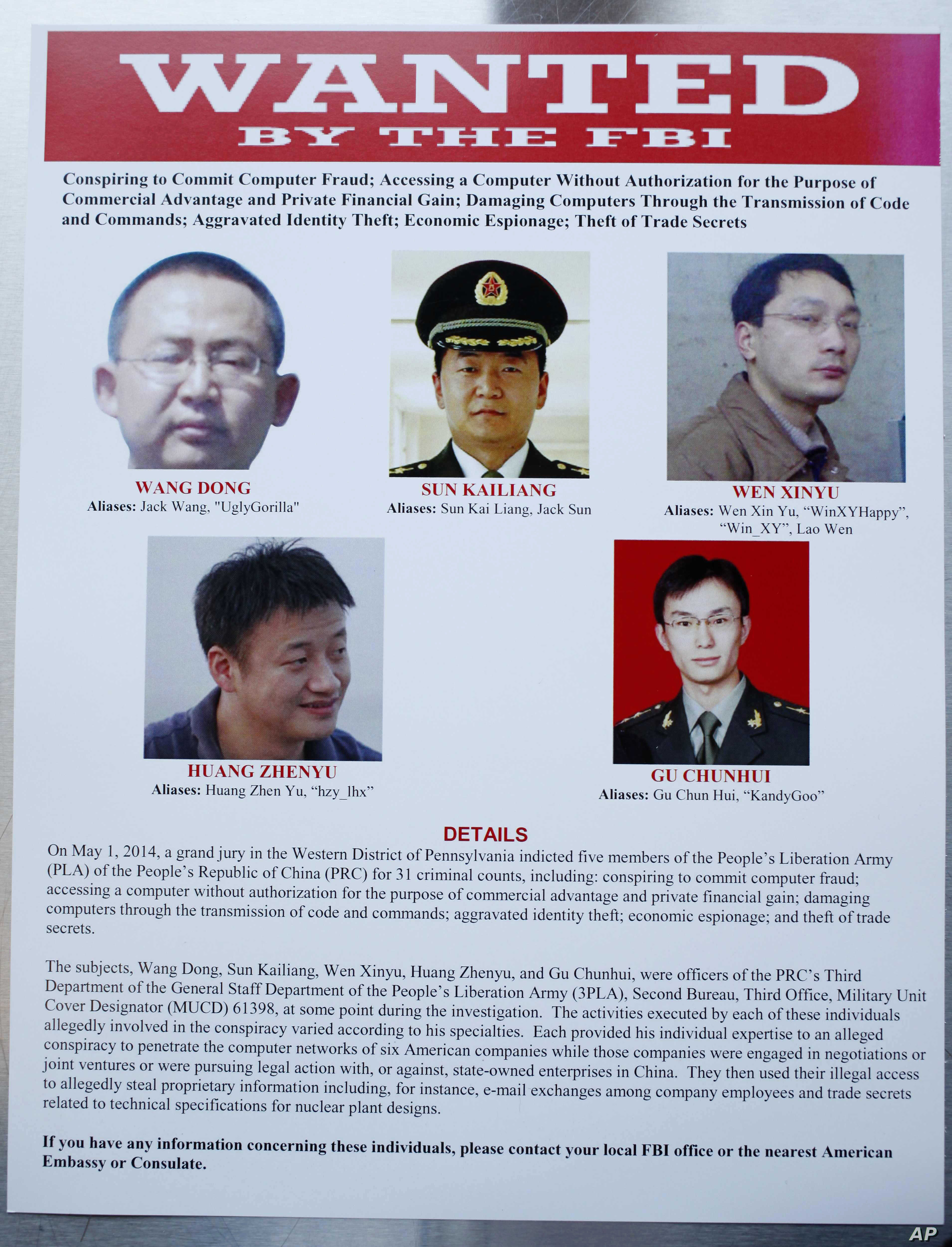 FILE: A poster of five Chinese military officers accused of stealing U.S. companies' trade secrets is displayed at the Justice Department in Washington, D.C., on May 19, 2014.