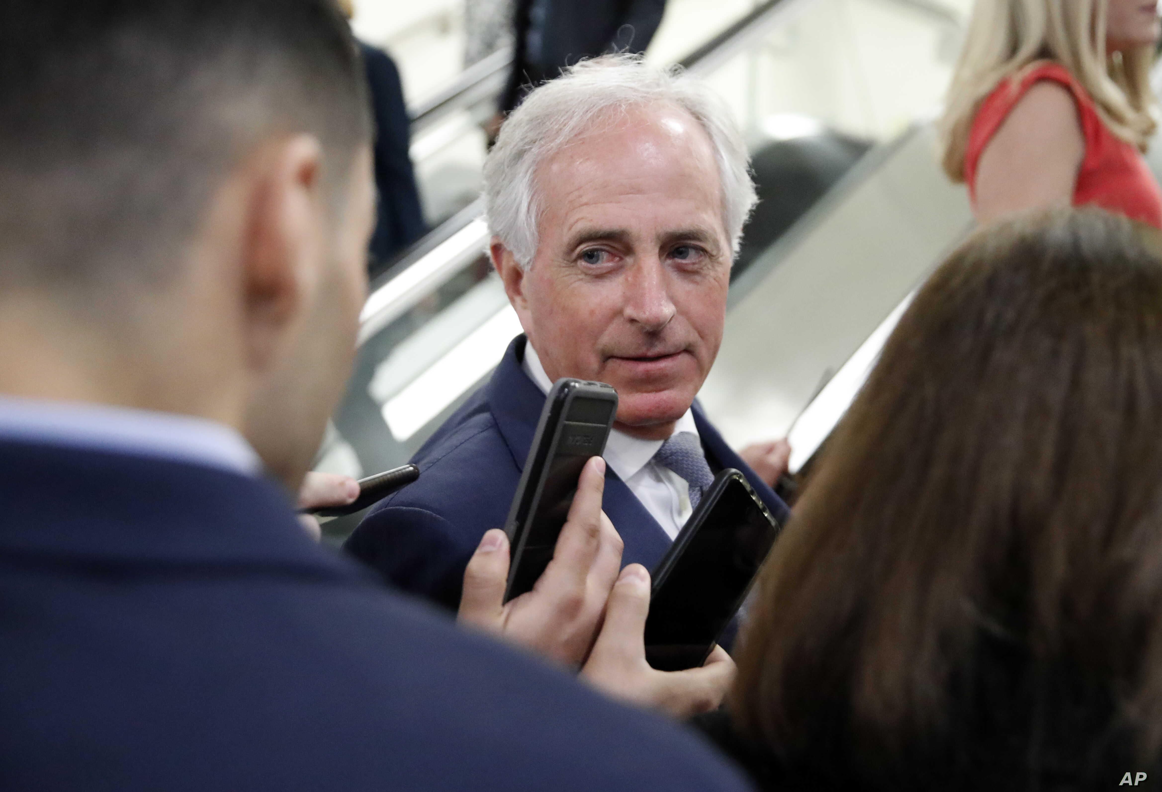 Sen. Bob Corker, R-Tenn., listens to a reporter's question on Capitol Hill, Oct. 3, 2018 in Washington.