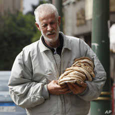 A man carries bread in Cairo on Feb. 6, 2011. Food prices continue to rise in Egypt.