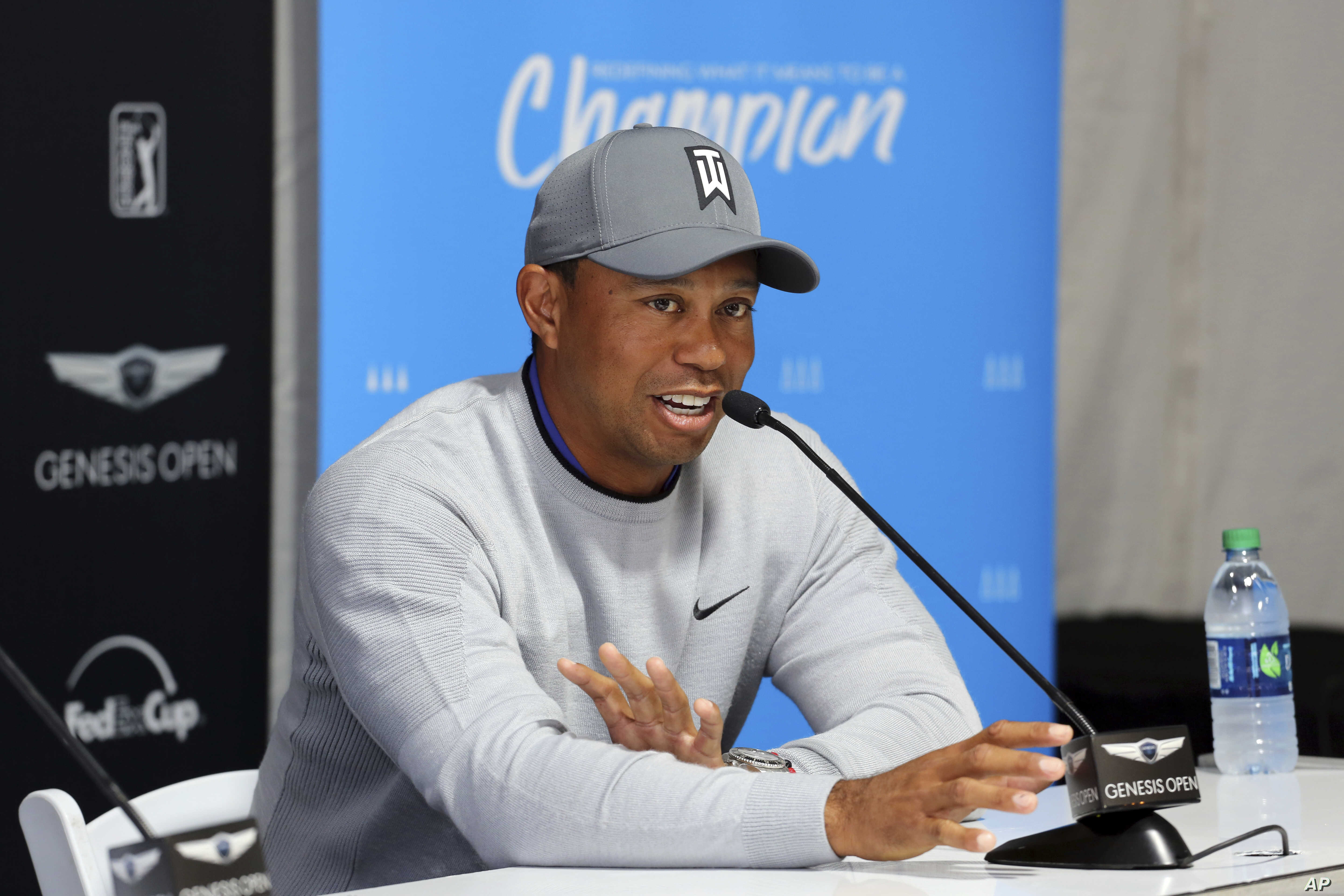 Tiger Woods talks about his charitable works off the course and his return to competitive golf in the Genesis Open at Riviera Country Club after an absence of 12 years, at the course in the Pacific Palisades area of Los Angeles, Feb. 13, 2018.