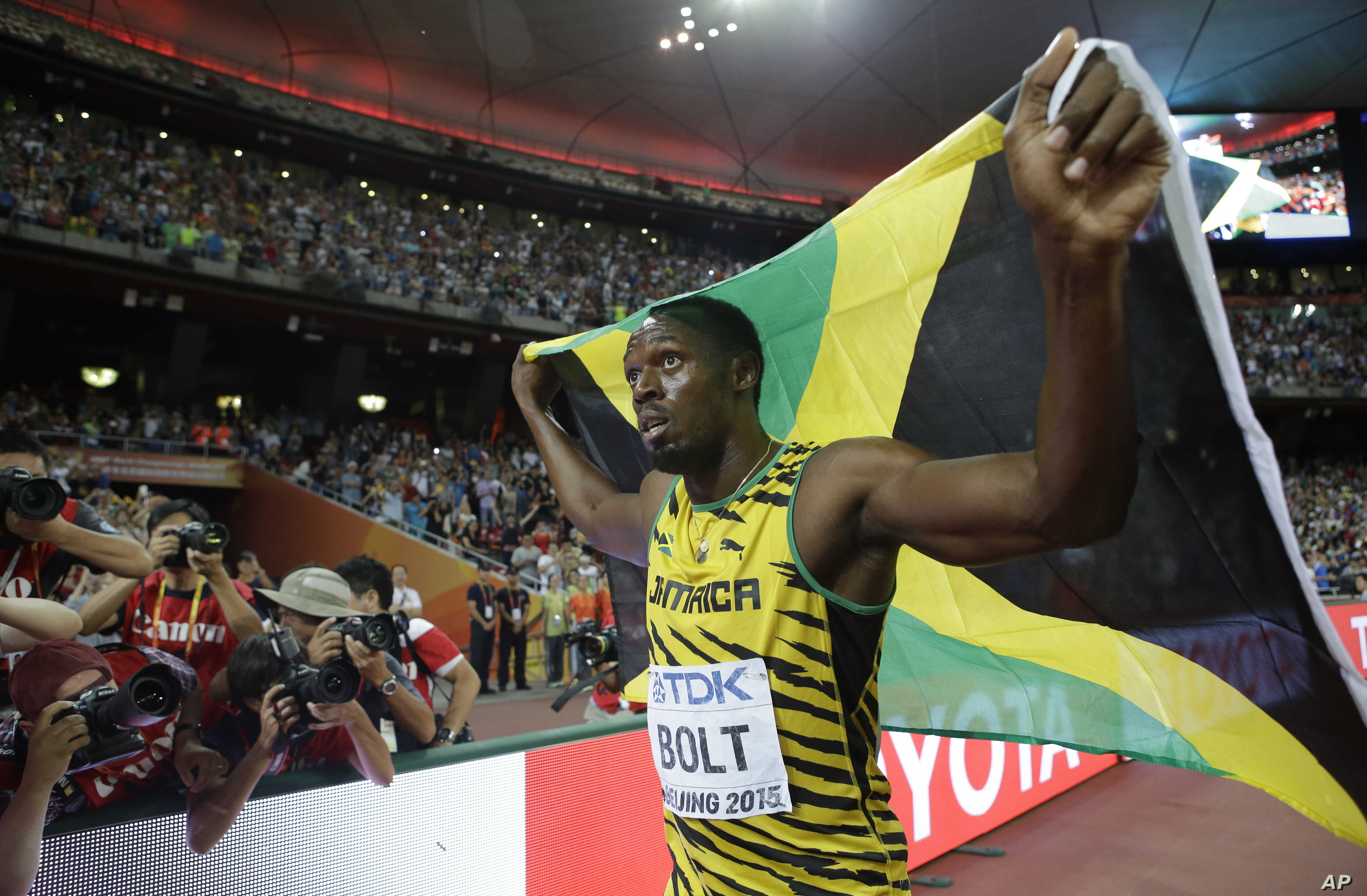 Jamaica's Usain Bolt celebrates after winning the gold medal in the men's 100m ahead of United States' at the World Athletics Championships at the Bird's Nest stadium in Beijing, Sunday, Aug. 23, 2015.