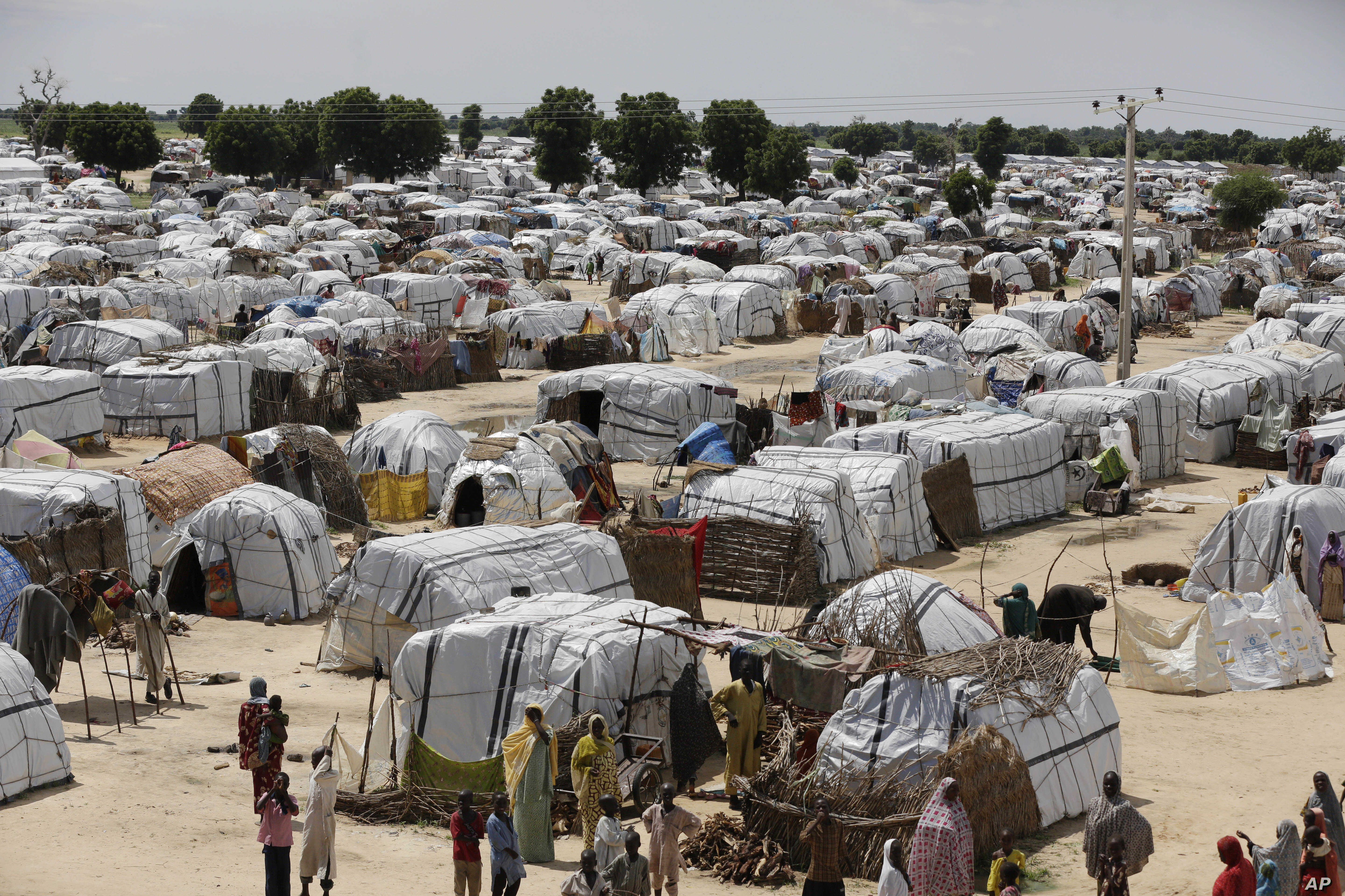 FILE - This view shows one of the biggest camps for people displaced by Islamist extremists in Maiduguri, Nigeria, Aug. 28, 2016. The U.N. Security Council on March 3, 2017, kicked off a visit to spotlight Africa's worst humanitarian crisis as millio...