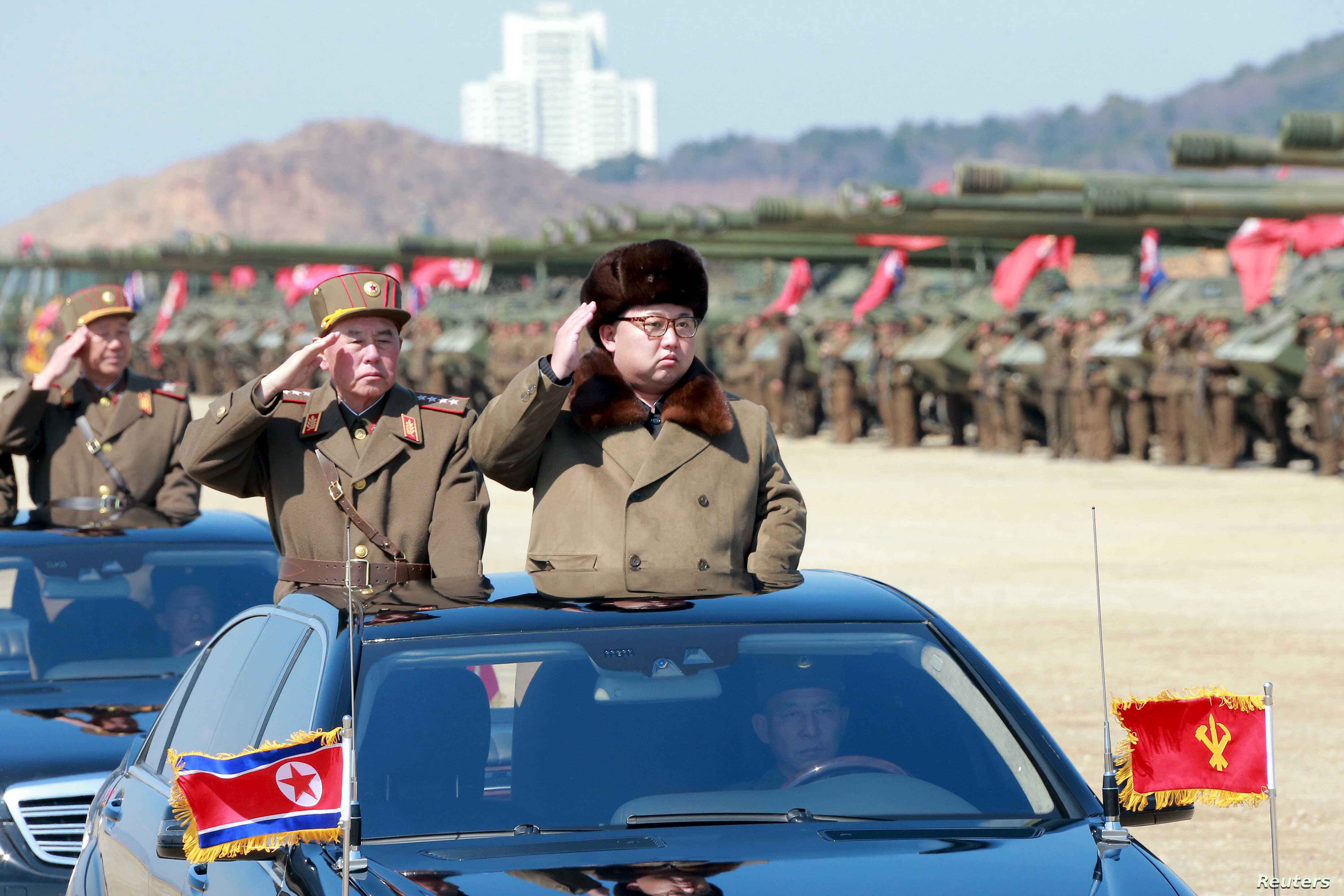 North Korean leader Kim Jong Un salutes as he arrives to inspect a military drill at an unknown location, in this undated photo released by North Korea's Korean Central News Agency, March 25, 2016.