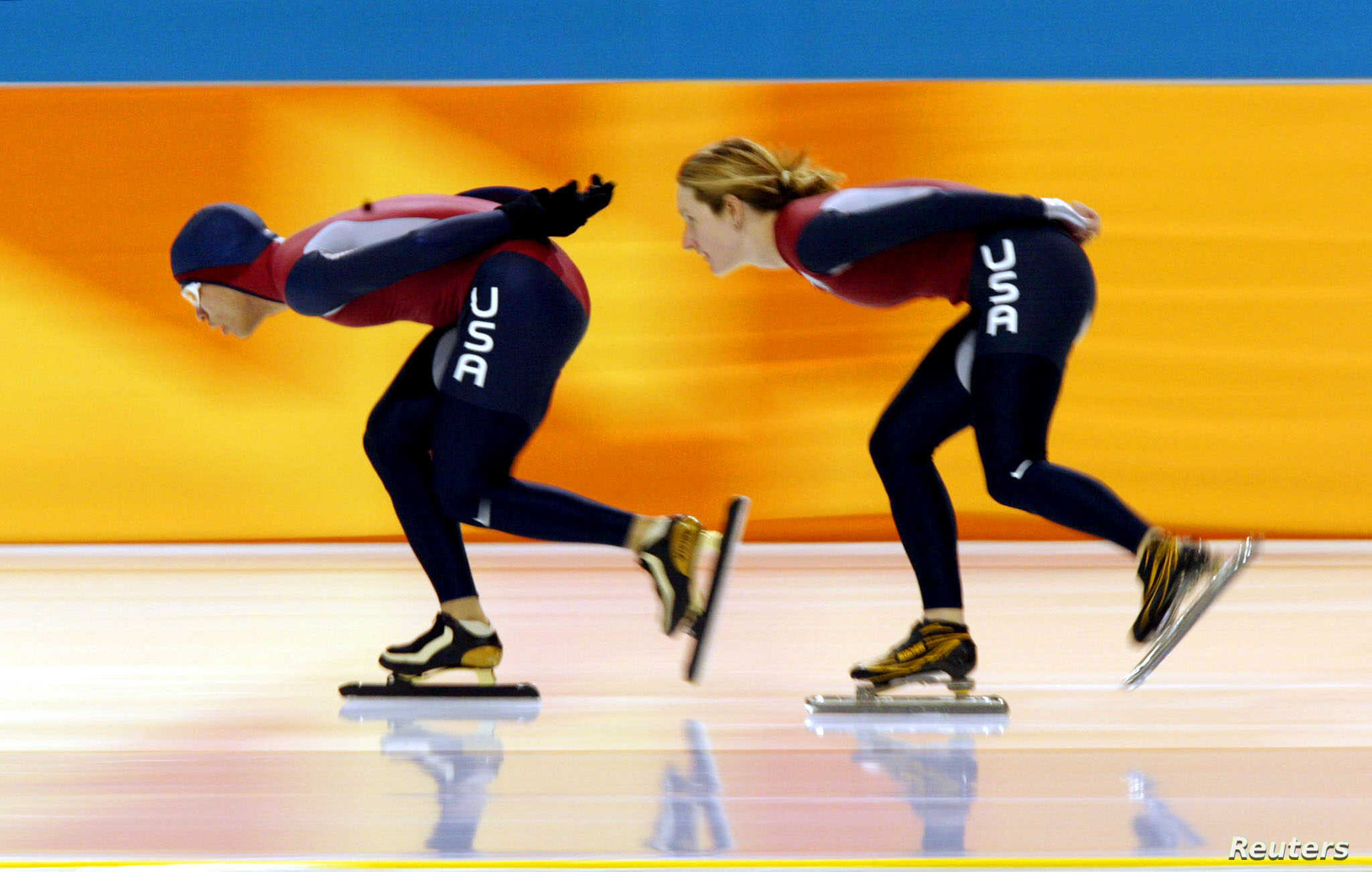 US speed skaters Derek Parra (L) and Jennifer Rodriguez work out at the Utah Olympic Oval in Salt Lake City, February 5, 2002.