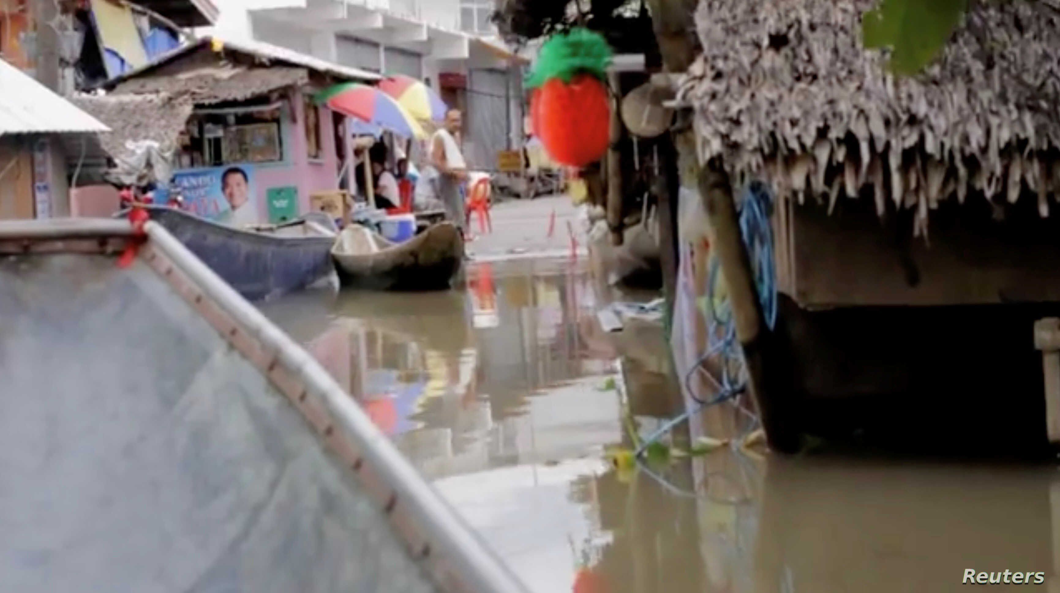 Flooding is seen in Bato, Camarines Sur, Philippines, Jan. 1, 2019 in this still image from video obtained from social media, Jan. 2, 2019.