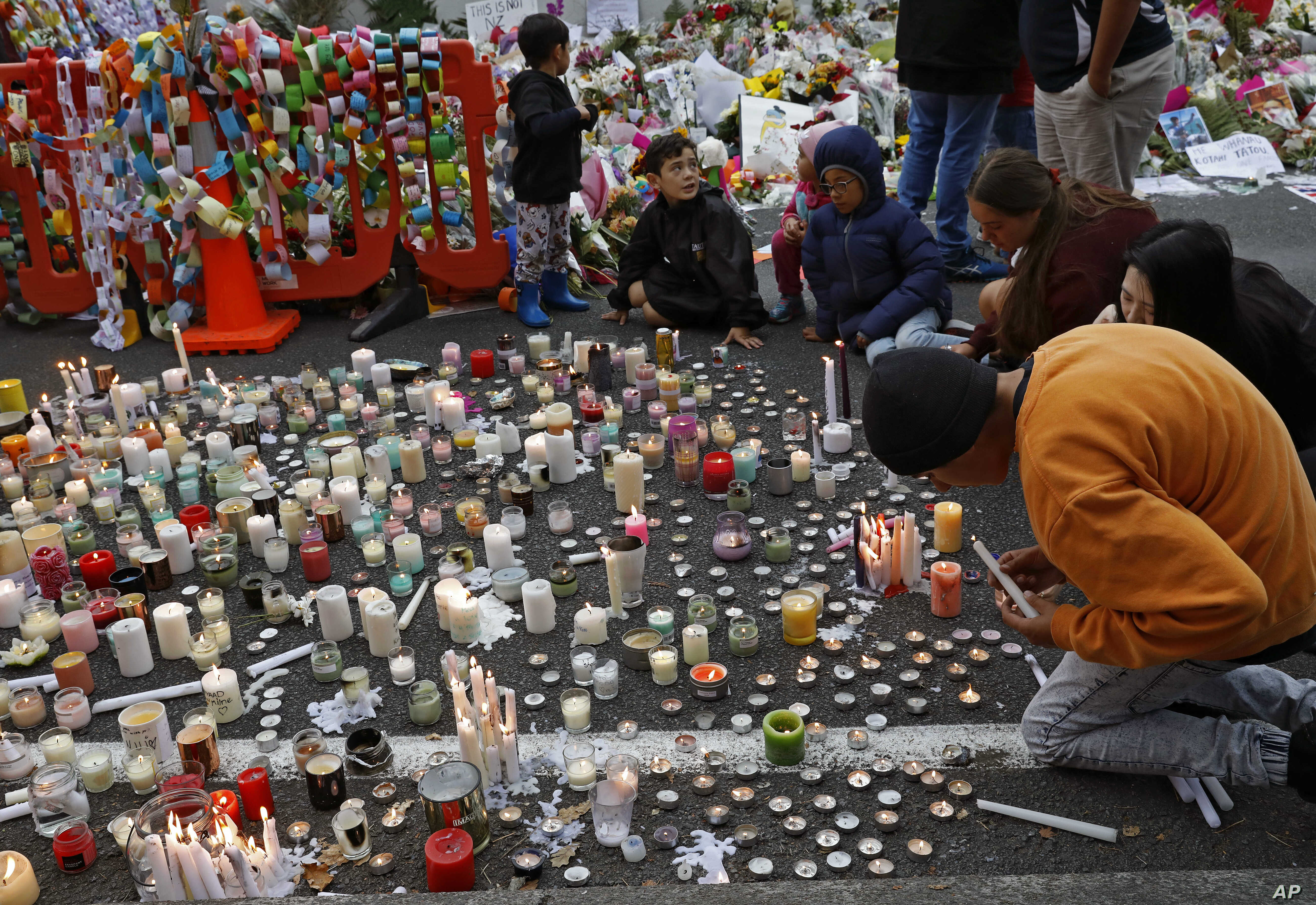 Students light candles as they gather for a vigil to commemorate victims of Friday's shooting, outside the Al Noor mosque in Christchurch, New Zealand, March 18, 2019.