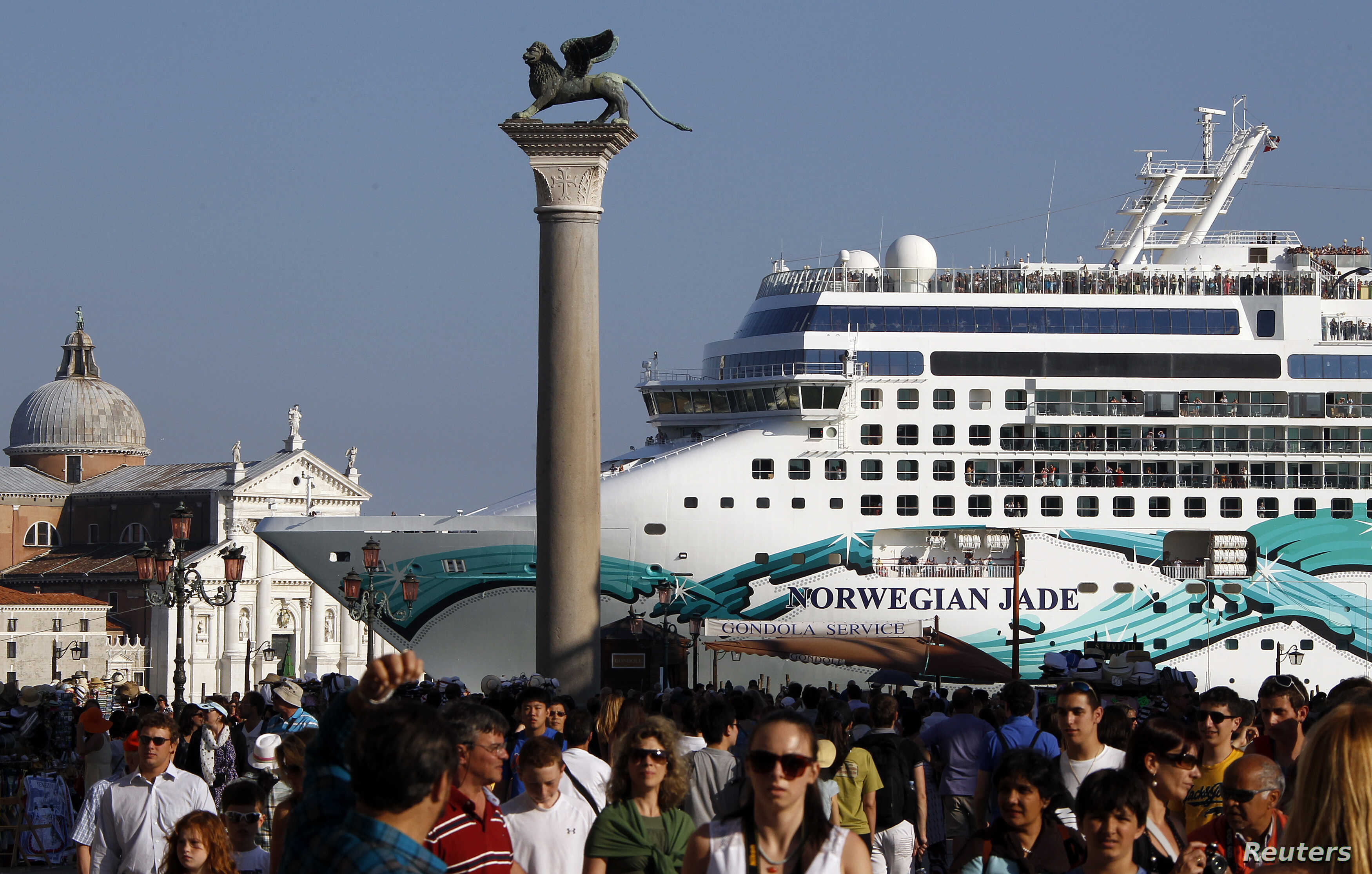FILE - The Norwegian Jade cruise ship is seen from St. Mark square in Venice lagoon, June 16, 2012.