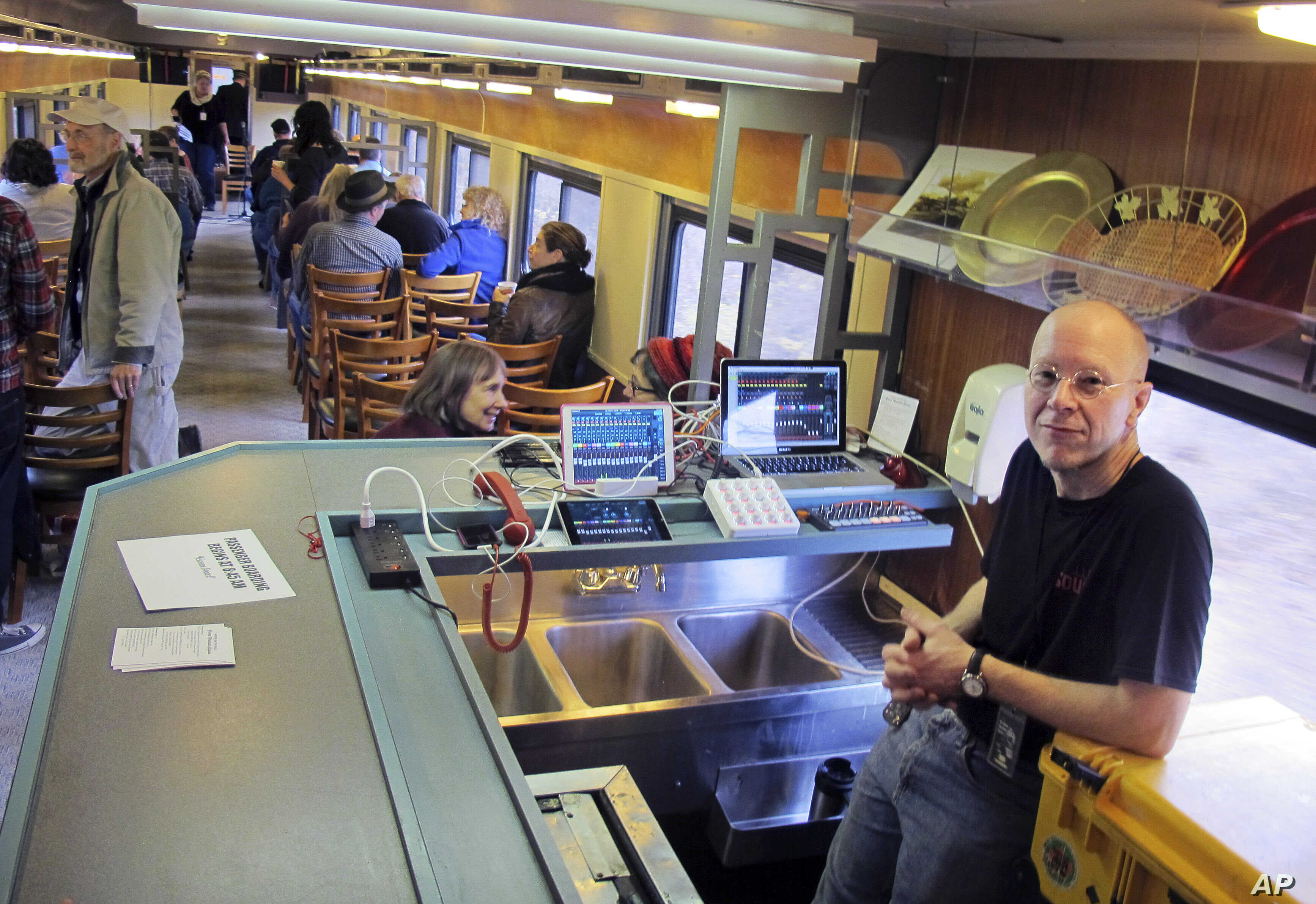 In this Saturday Nov. 7, 2015 photo, sound technician Dan Richardson rides aboard the Roots on the Rails music train during its first East Coast excursion between Bellows Falls and Rutland, Vt.