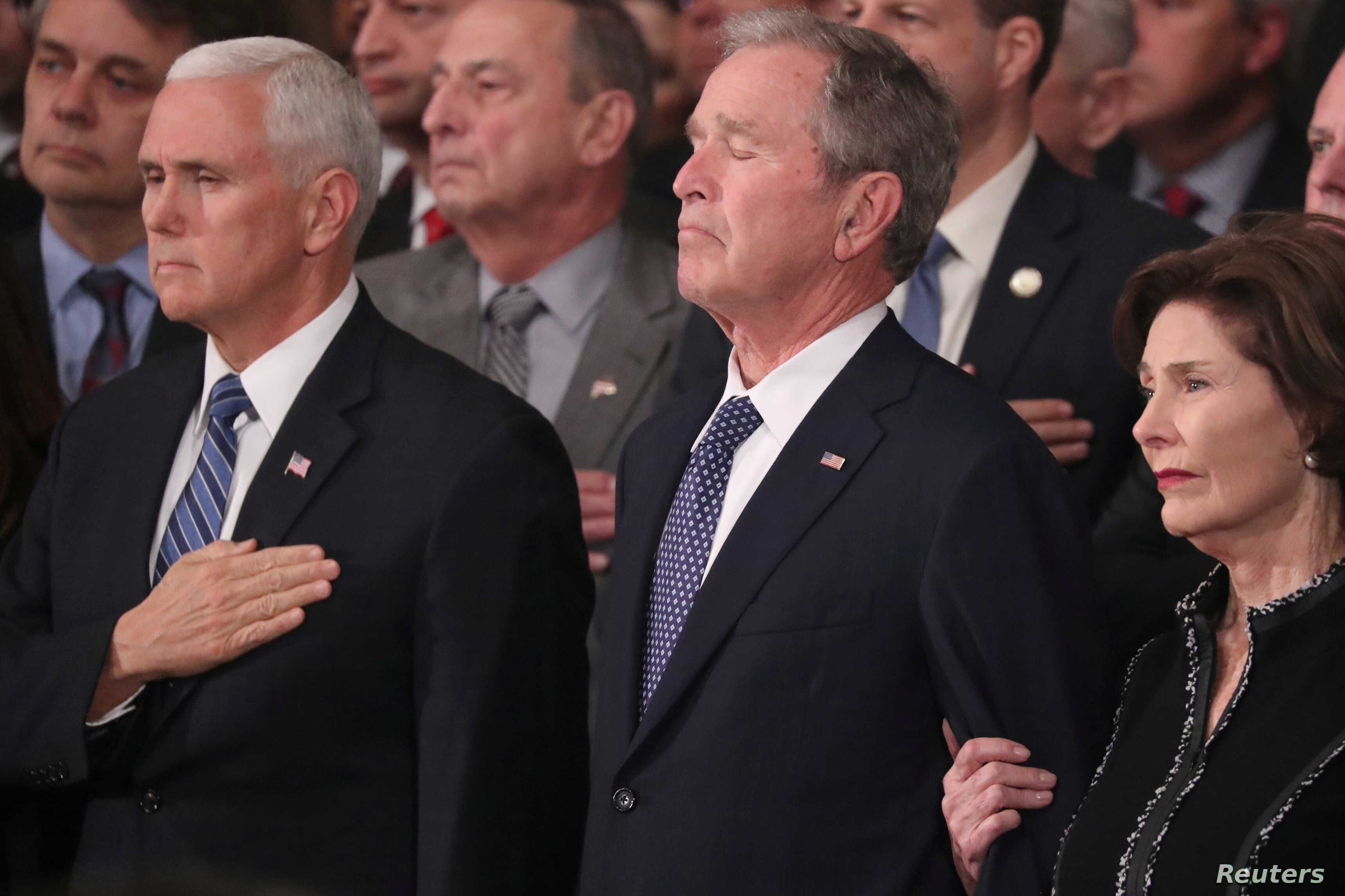 U.S. Vice President Mike Pence, former President George W. Bush and former first lady Laura Bush watch as the casket of former President George H.W. Bush arrives to lie in state in the U.S. Capitol Rotunda in Washington, U.S., Dec. 3, 2018.