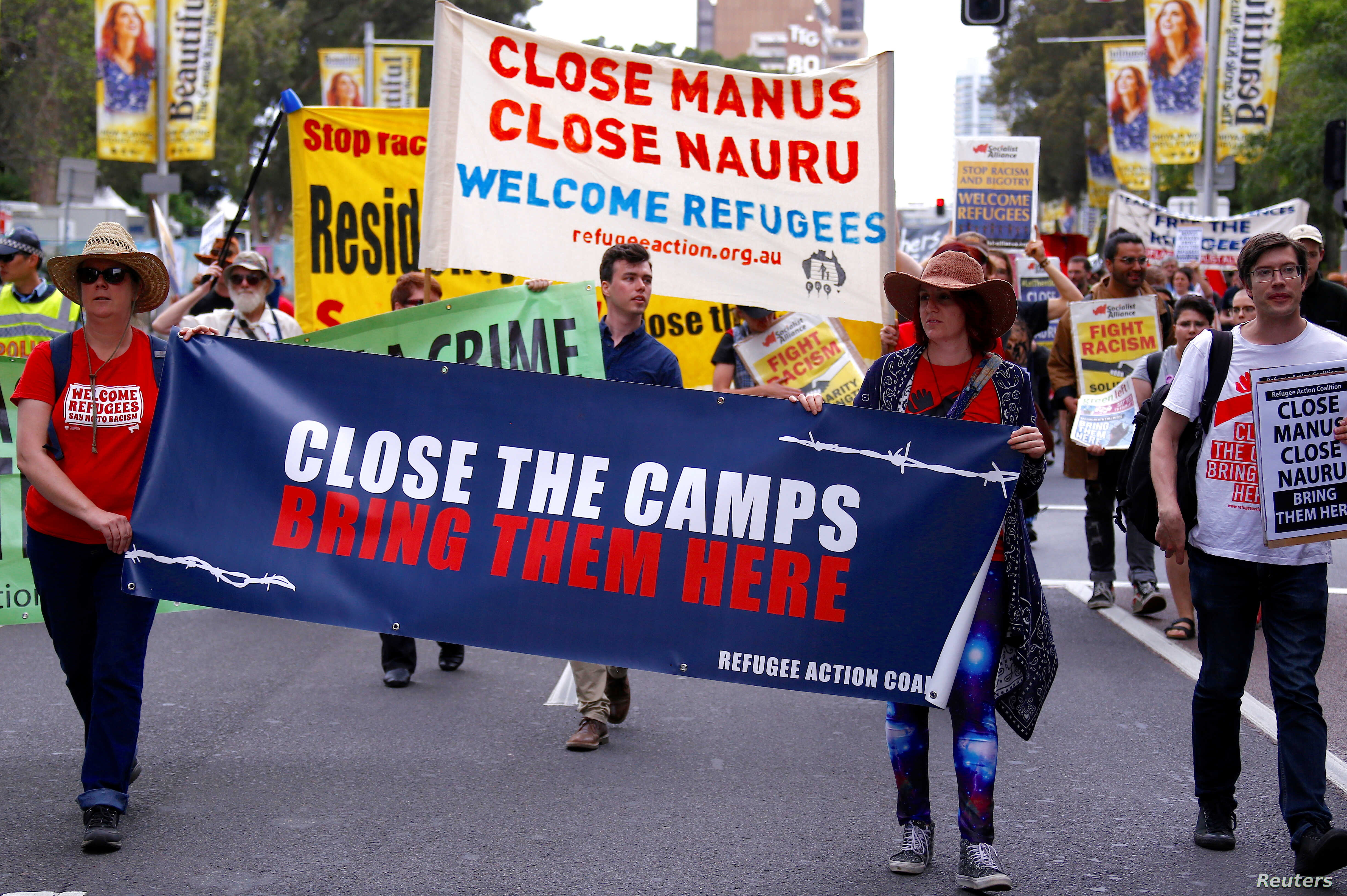 Refugee advocates protest in Sydney, Oct. 15, 2017, against the treatment of asylum-seekers in detention centers in Nauru and on Manus Island.