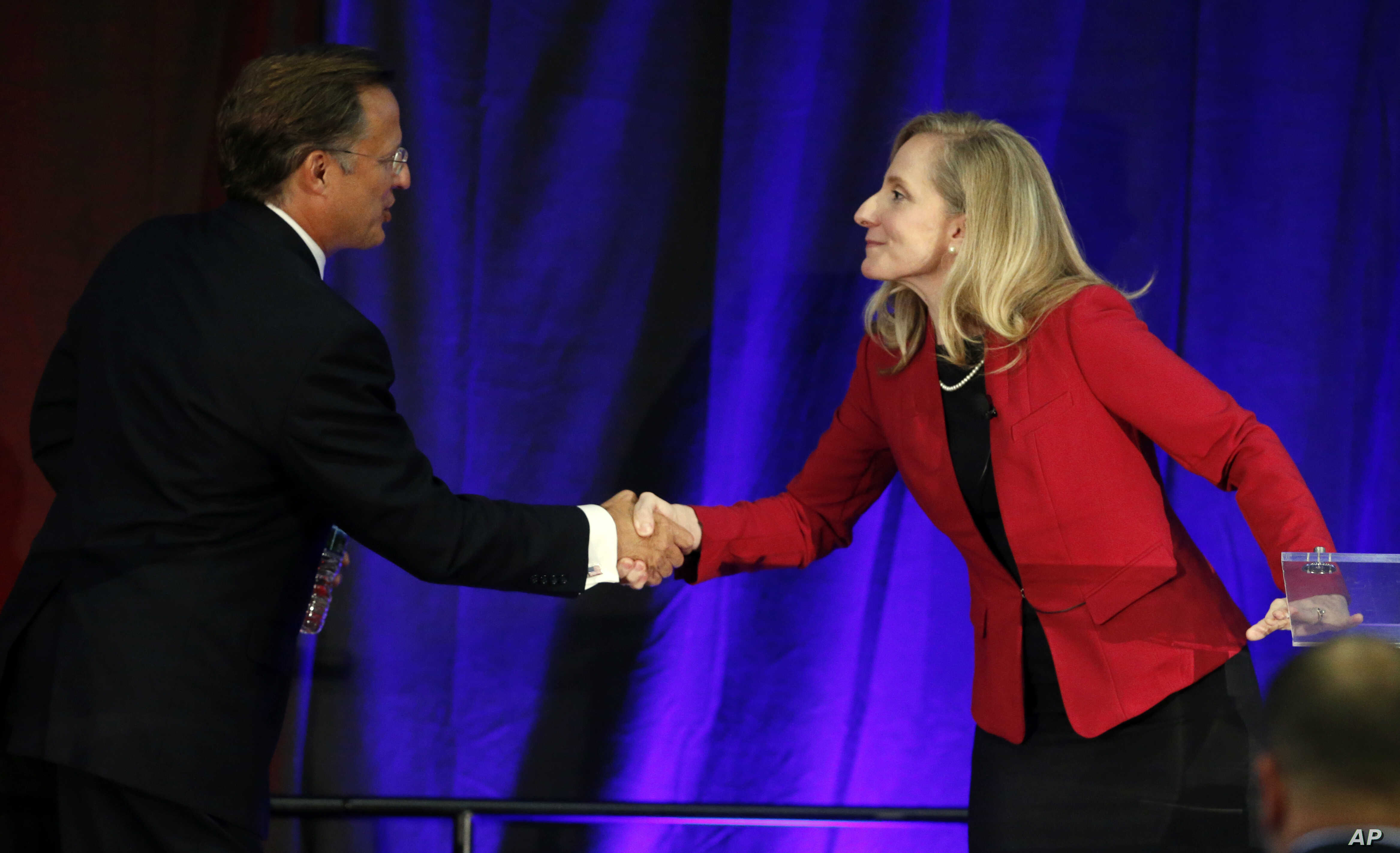 Virginia Congressman Dave Brat, R-Va., left, shakes hands with Democratic challenger Abigail Spanberger, right, after a debate at Germanna Community College in Culpeper, Virginia, Oct. 15, 2018.