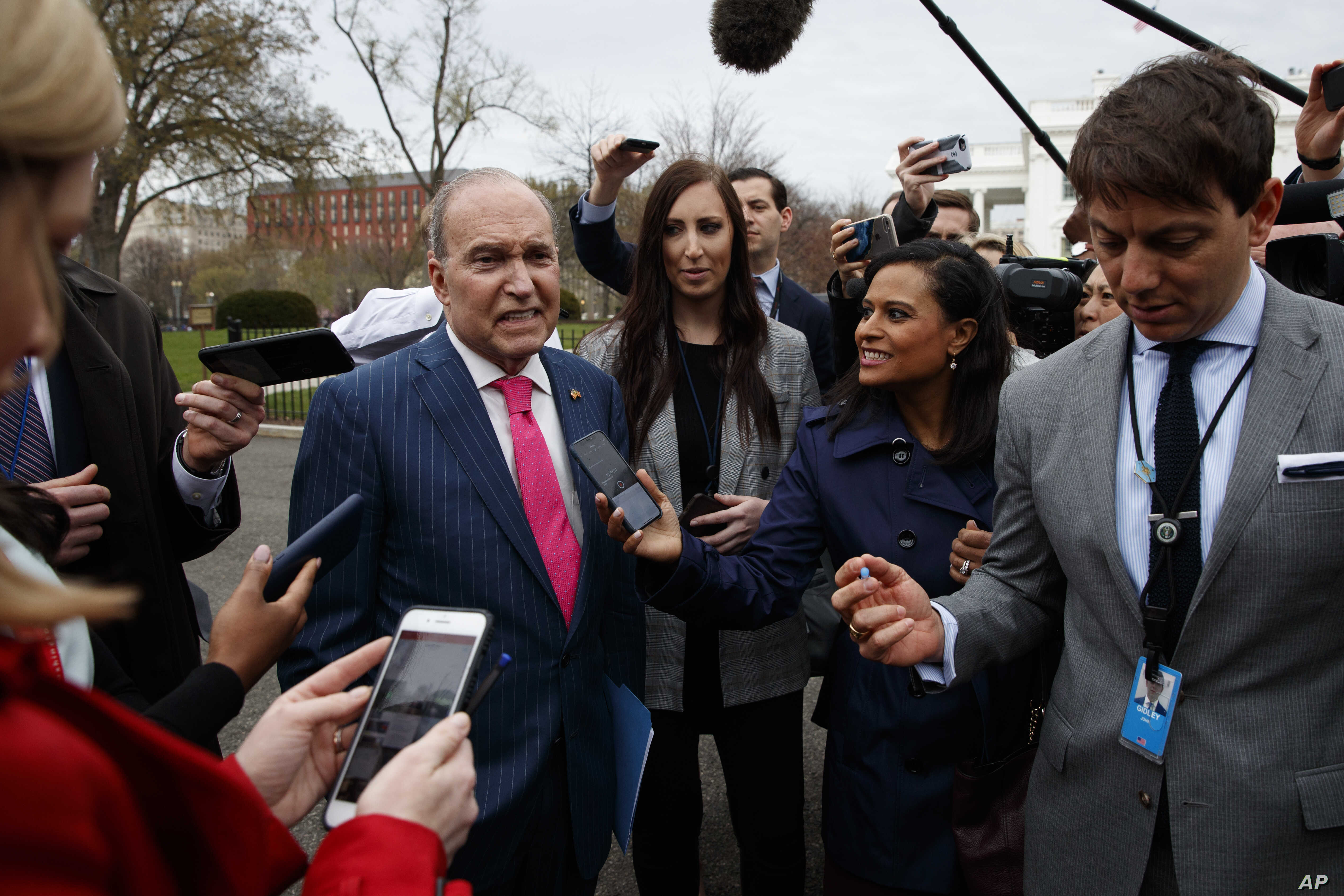 White House chief economic adviser Larry Kudlow talks with reporters outside the White House, April 4, 2018, in Washington.