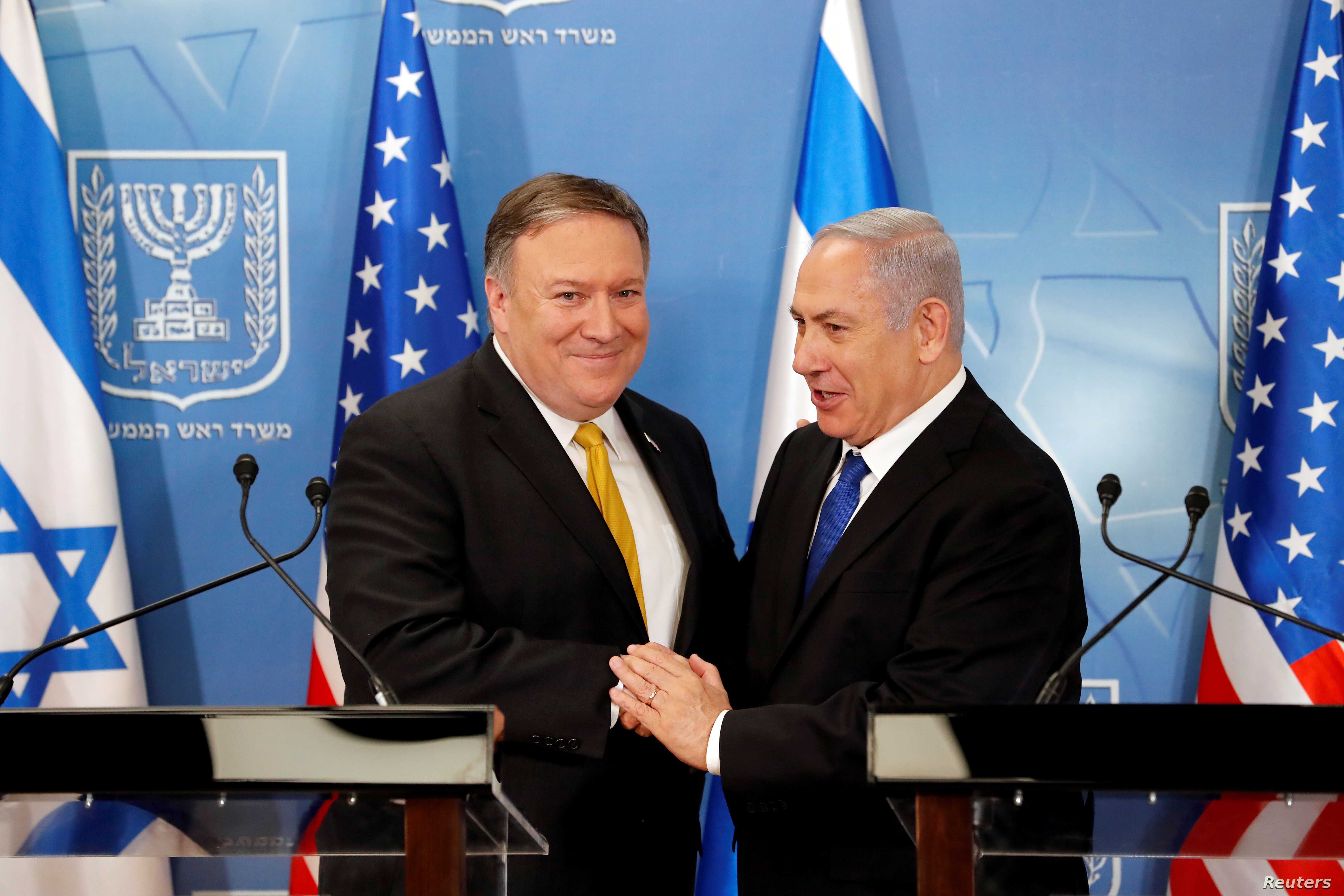 Israeli Prime Minister Benjamin Netanyahu shakes hands with U.S. Secretary of State Mike Pompeo during a meeting at the Ministry of Defence in Tel Aviv, Israel, April 29, 2018