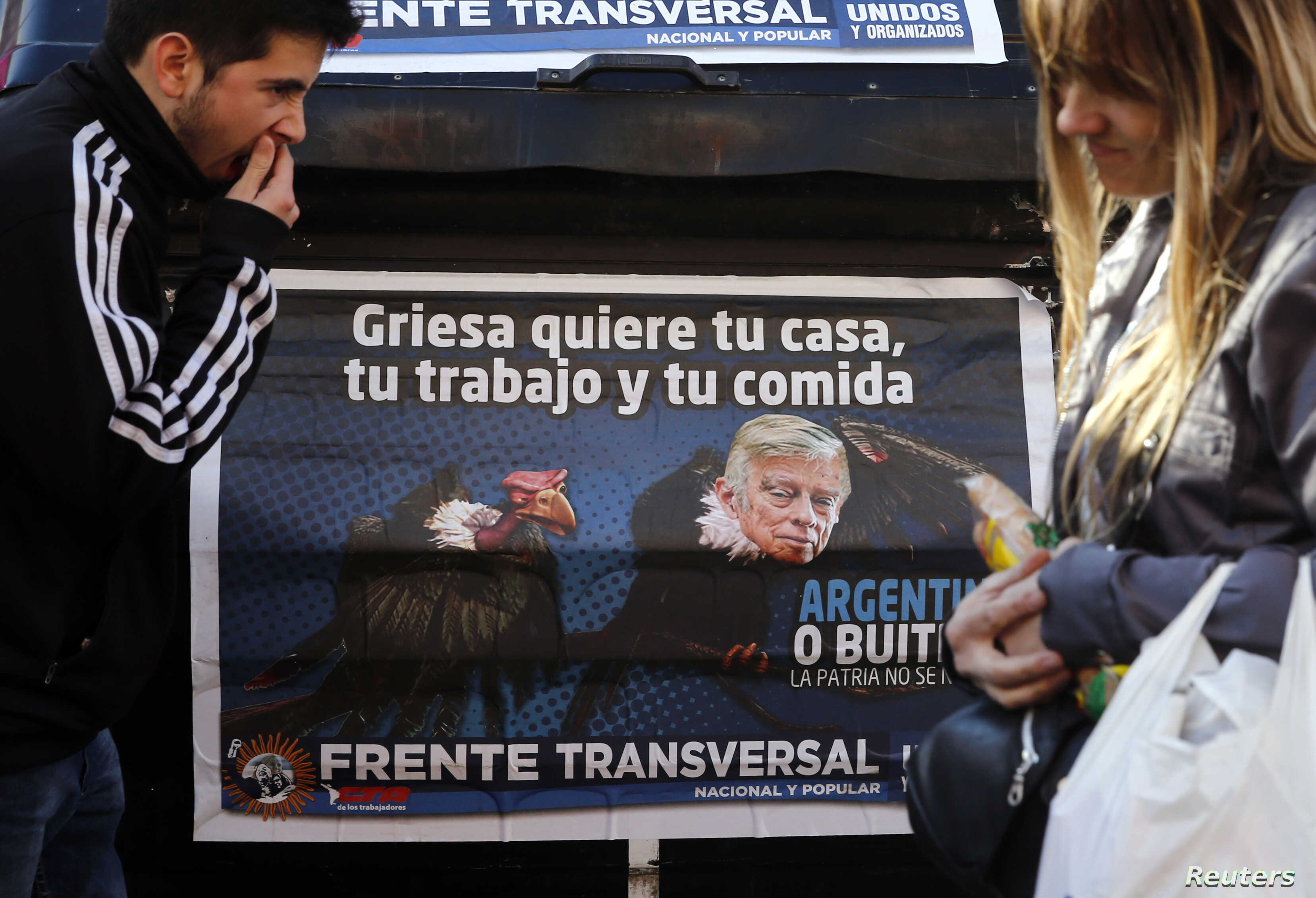 A poster depicts U.S. District Court Judge Thomas Griesa, overseeing a case in which U.S. hedge funds are suing Argentina, as a vulture in Buenos Aires, Aug. 12, 2014.