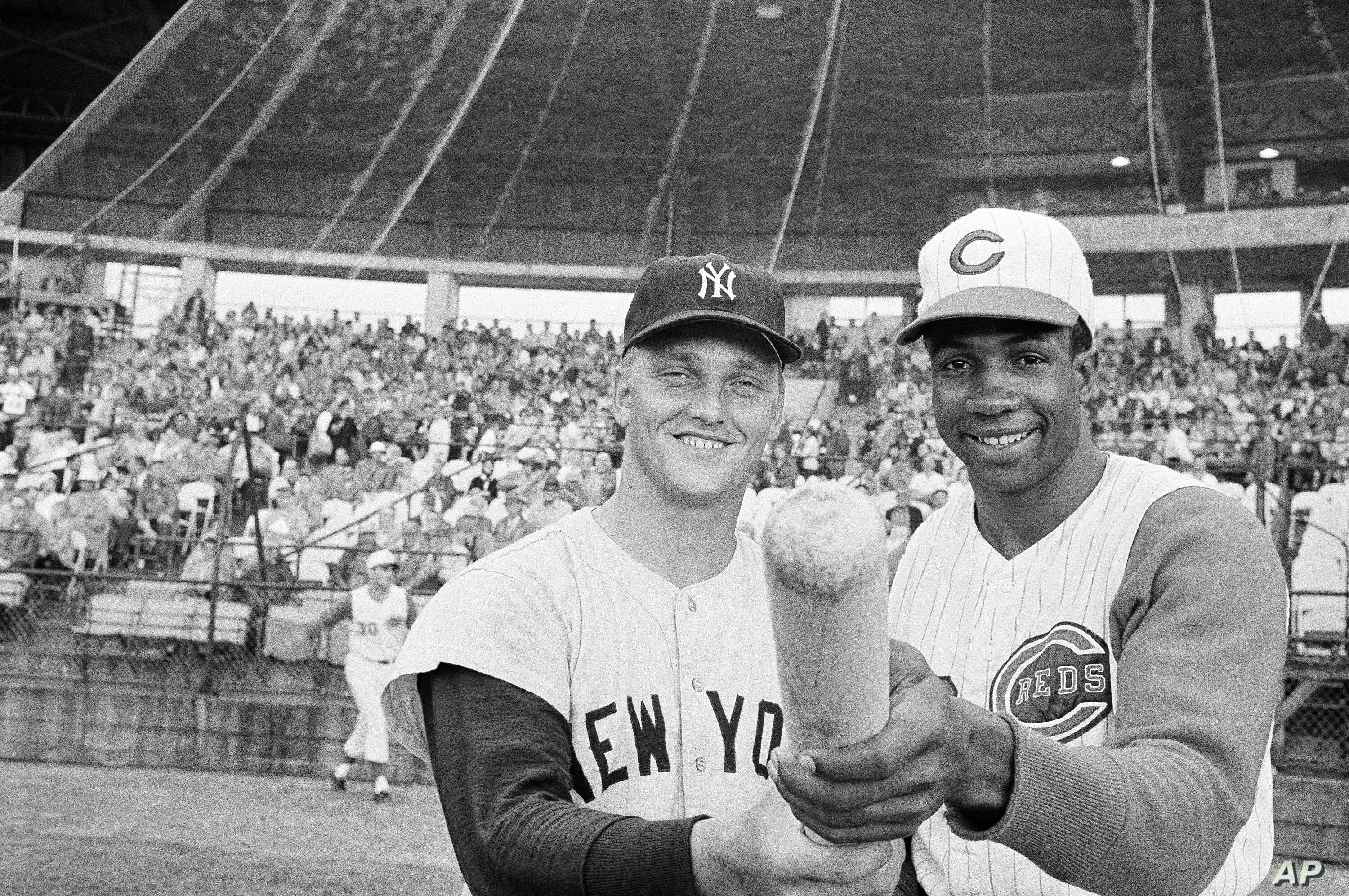 Roger Maris of the N.Y Yankees and Frank Robinson of the Cincinnati Reds pose before an exhibition game in Tampa, Florida, March 26, 1962. Maris was voted the MVP in the American League and Frank Robinson received the National League's award.