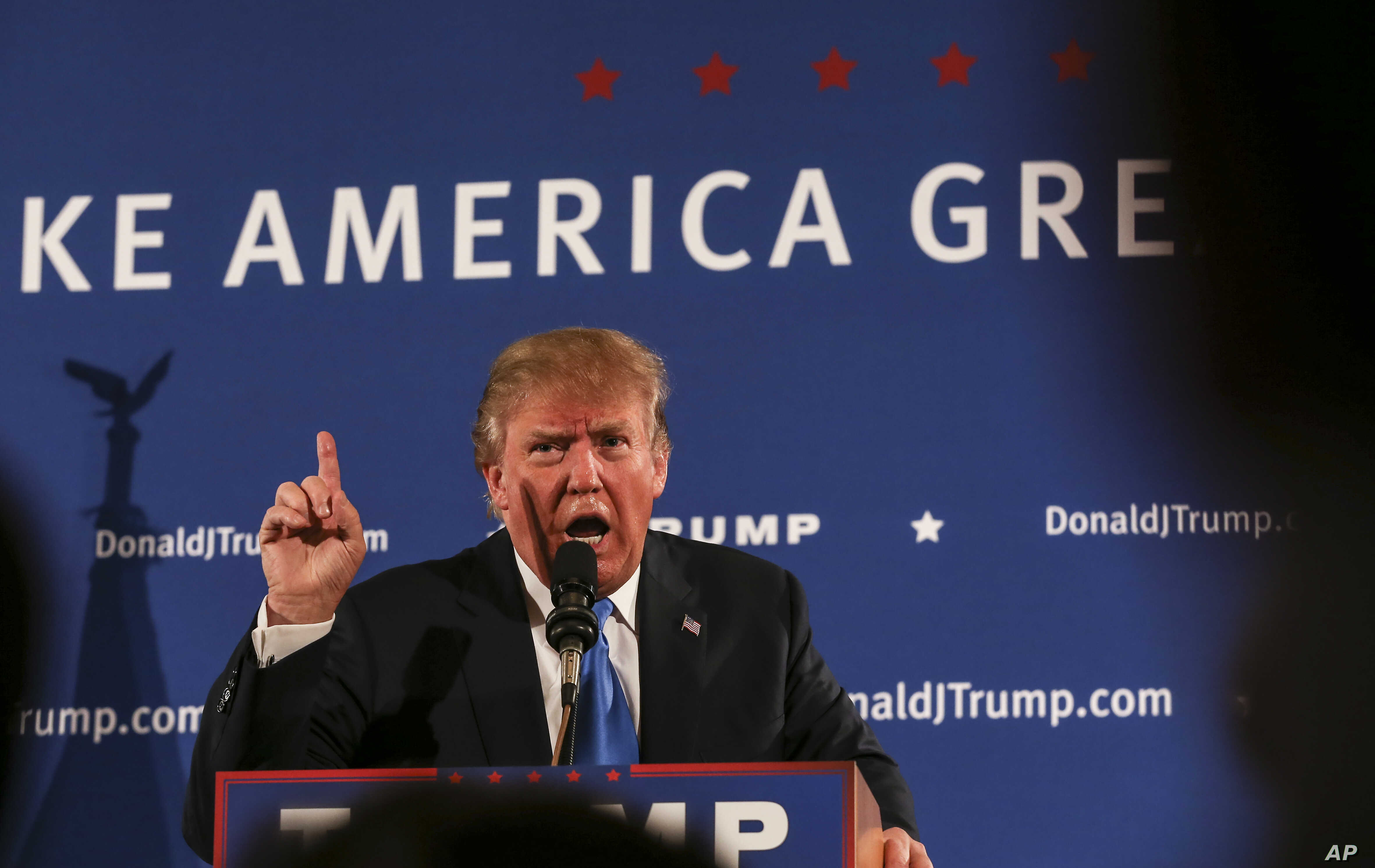 Republican presidential candidate Donald Trump gestures while speaking at a town hall meeting at Atkinson Country Club in Atkinson, N.H., Oct. 26, 2015.