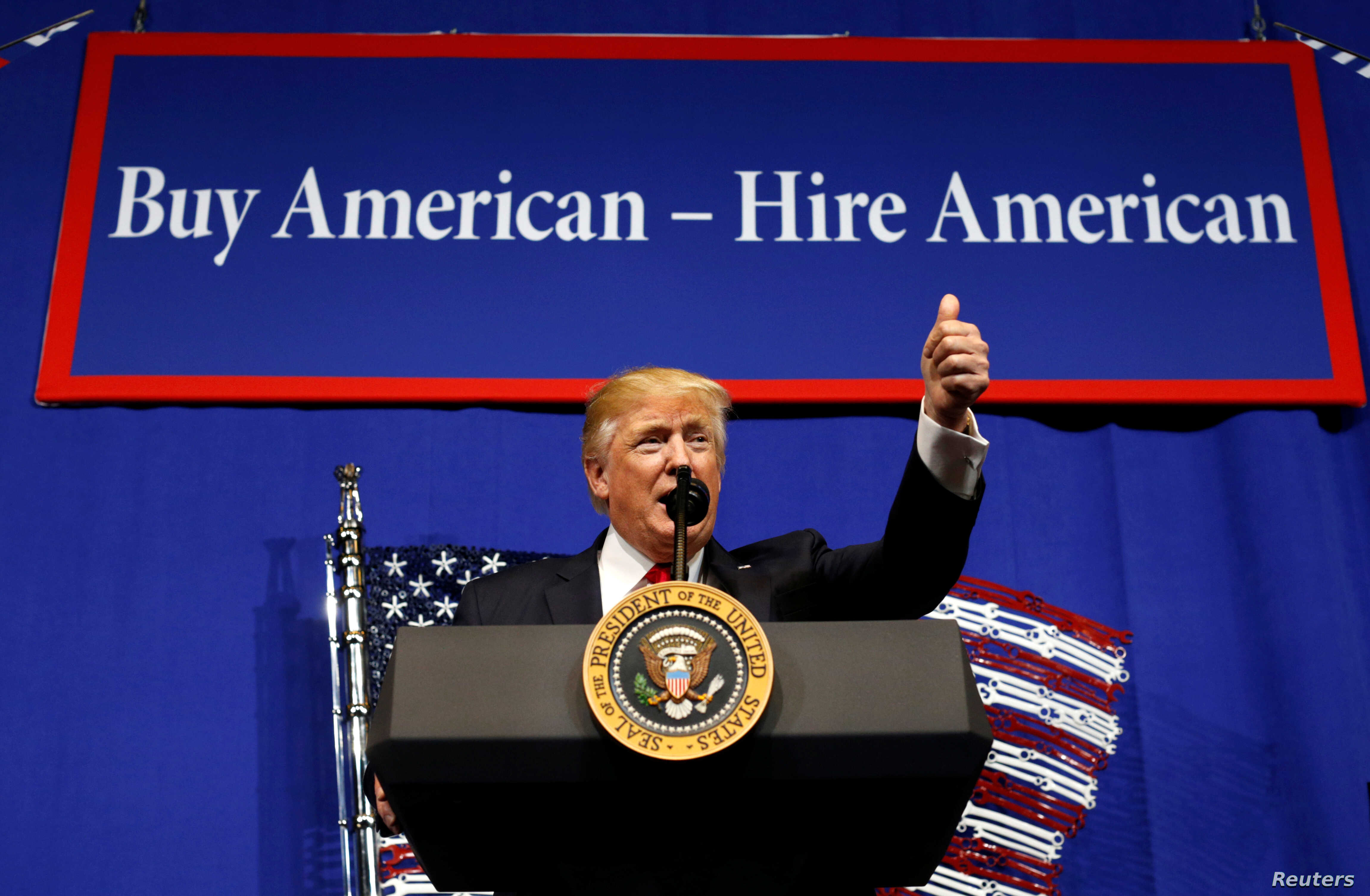 U.S. President Donald Trump speaks before signing an executive order directing federal agencies to recommend changes to a temporary visa program used to bring foreign workers to the United States to fill high-skilled jobs during a visit to the world ...