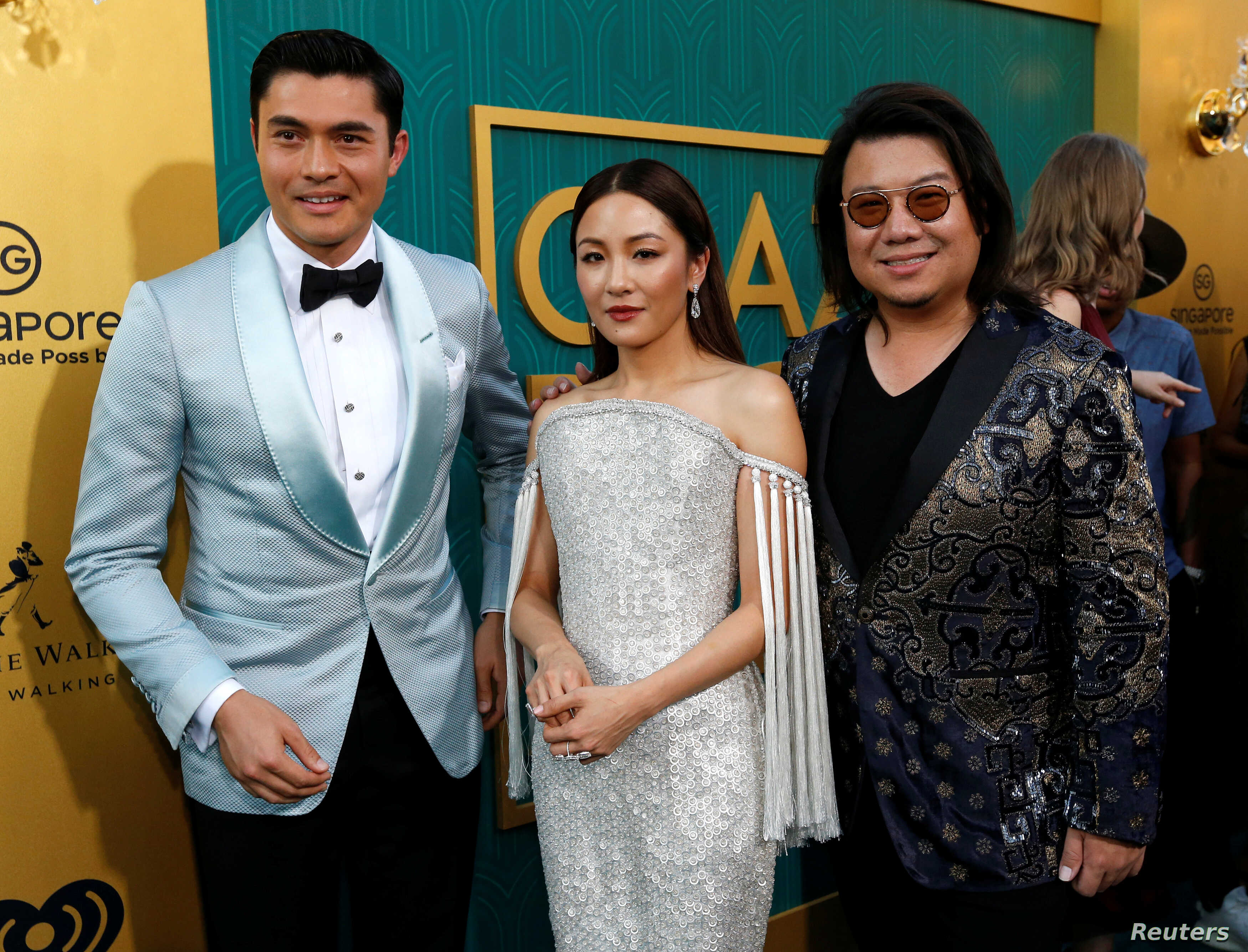 """Author Kevin Kwan (R) and cast members Henry Golding and Constance Wu pose at the premiere for """"Crazy Rich Asians"""" in Los Angeles, California, U.S., August 7, 2018."""