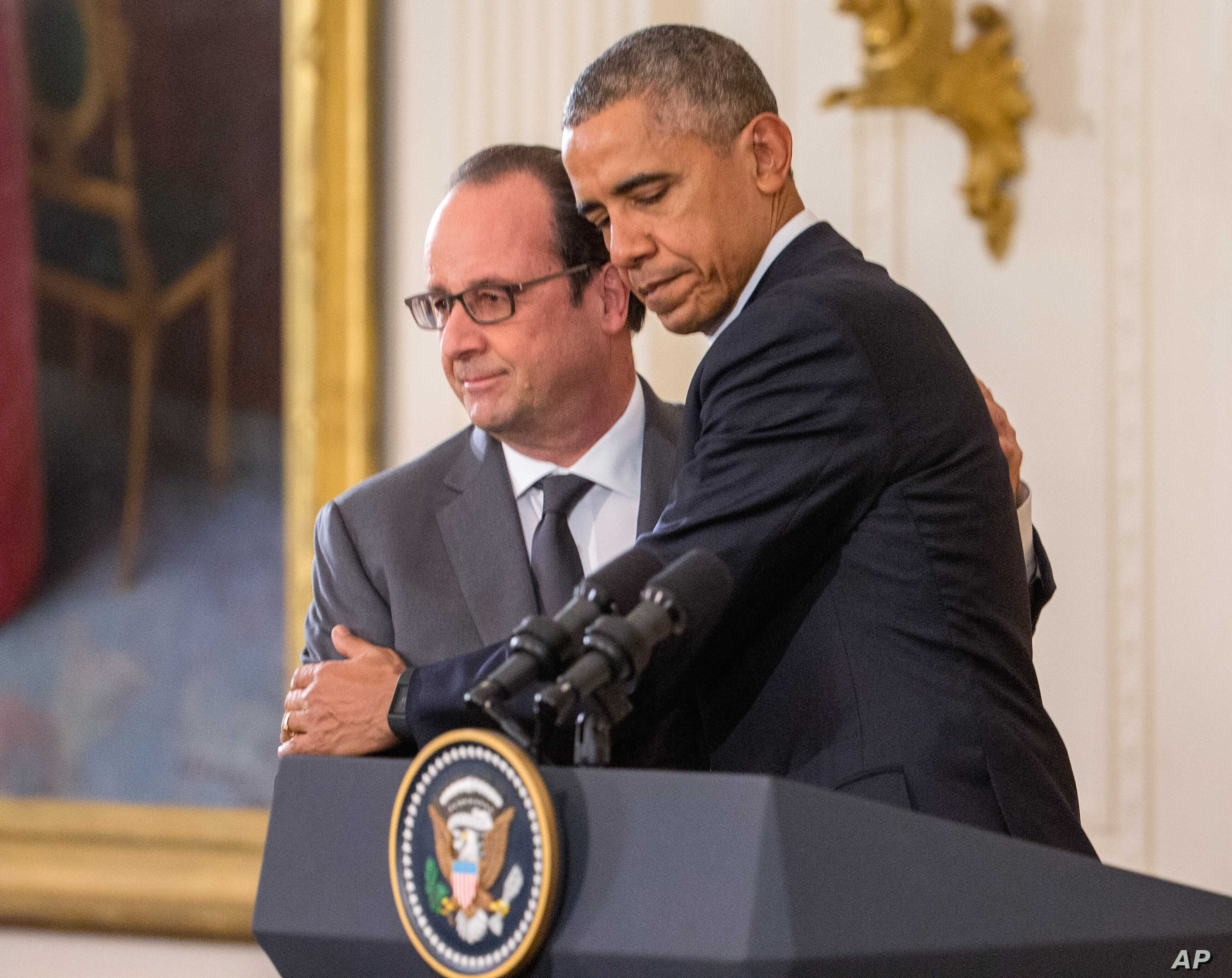 President Barack Obama and French President Francois Hollande embrace during a joint news conference in the East Room of the White House in Washington, Nov. 24, 2015.