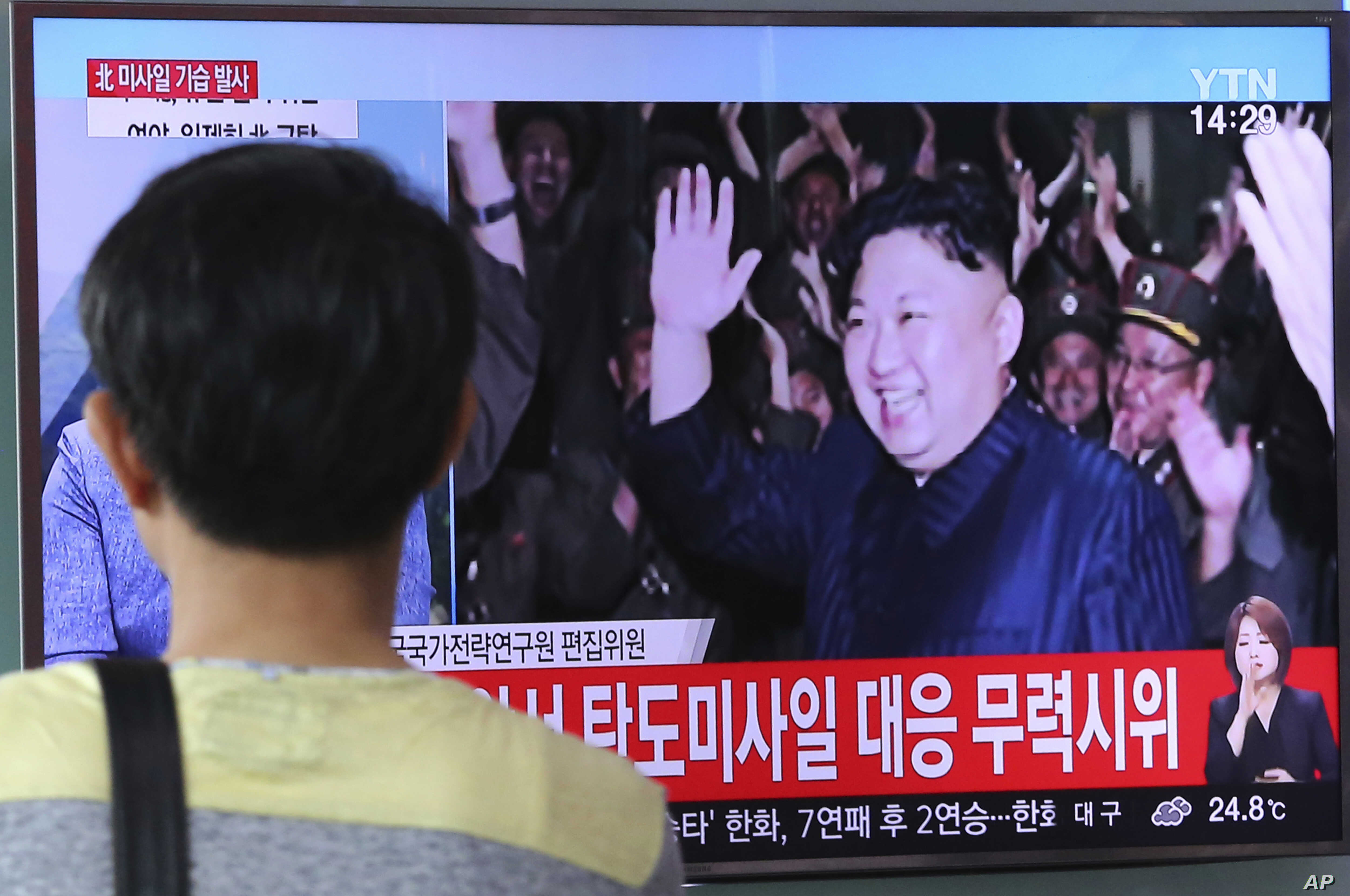 A man watches a TV news program showing an image of N. Korean leader Kim Jong un during the North's latest test launch of an intercontinental ballistic missile, at Seoul Railway Station in Seoul, S. Korea, July 29, 2017.
