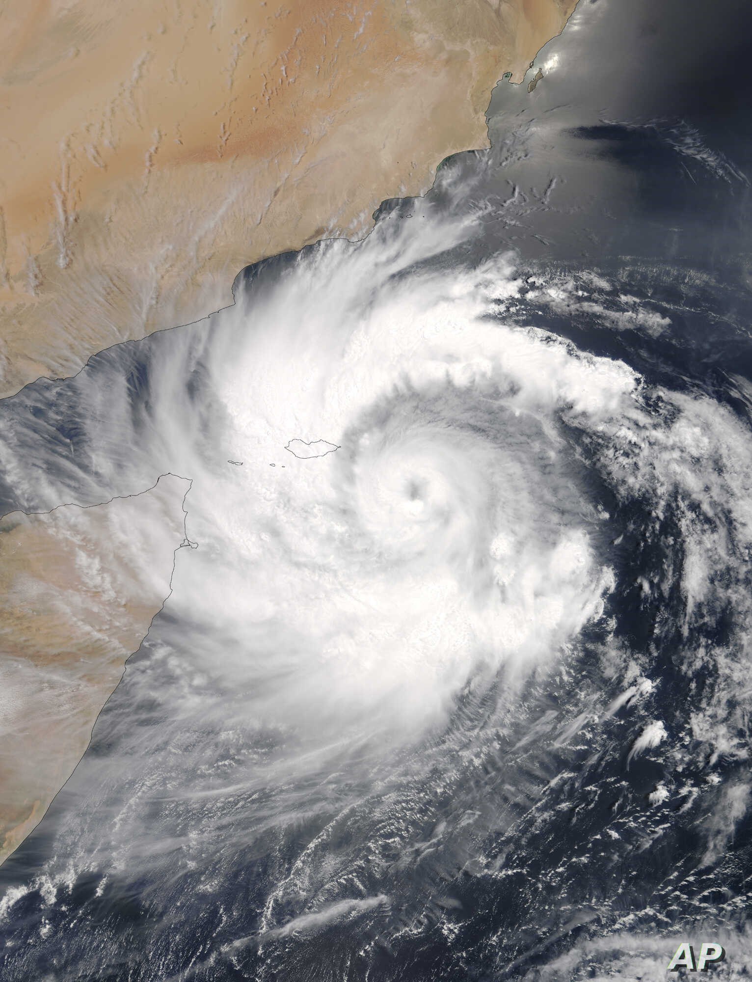 This satellite image provided by NASA shows Cyclone Mekunu over the Yemeni island of Socotra in the Arabian Sea as it heads for the coast of Oman, May 23, 2018.