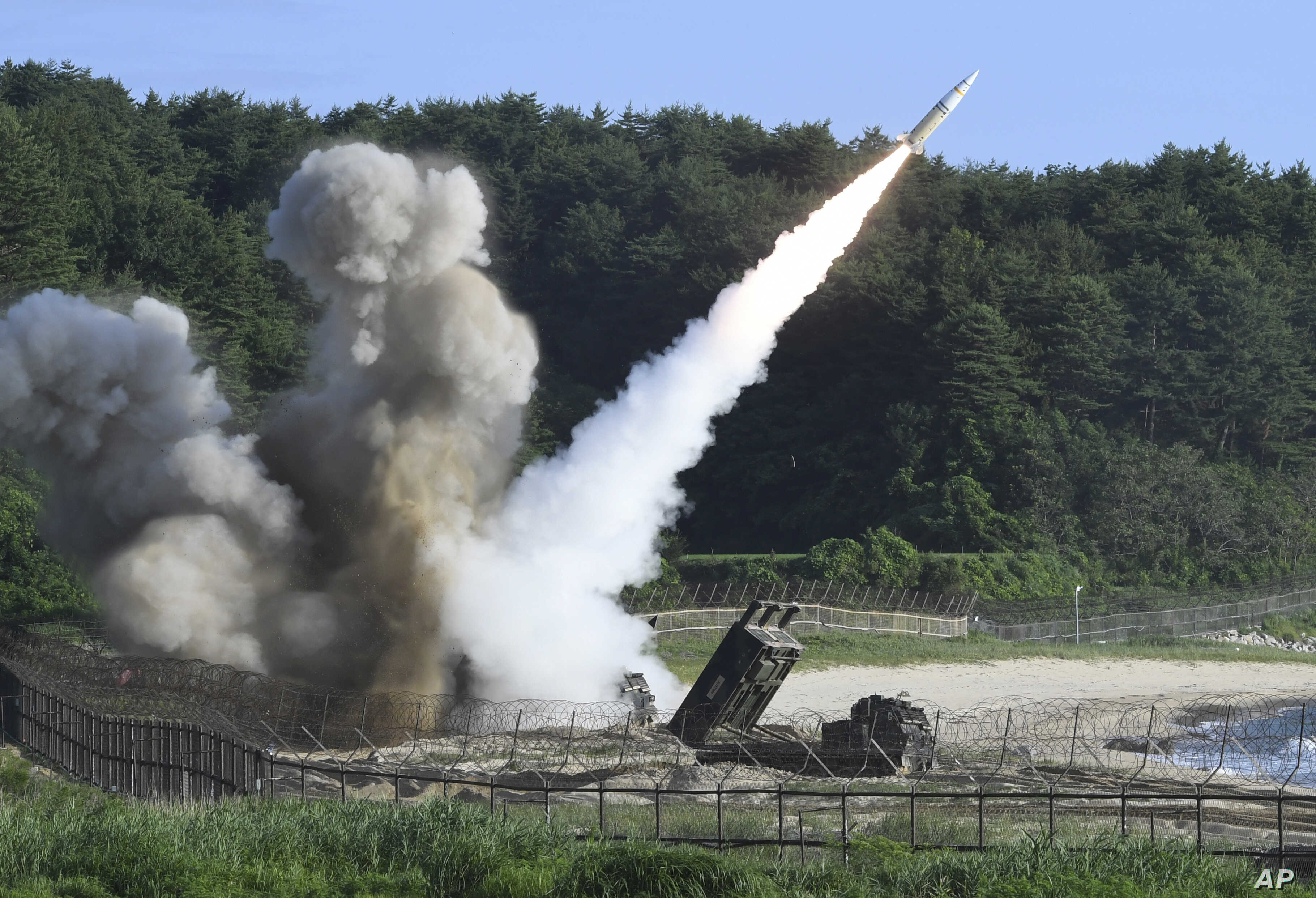 In this photo provided by South Korea Defense Ministry, a U.S. MGM-140 Army Tactical Missile is fired during the combined military exercise between the U.S. and South Korea against North Korea at an undisclosed location in South Korea, July 5, 2017.