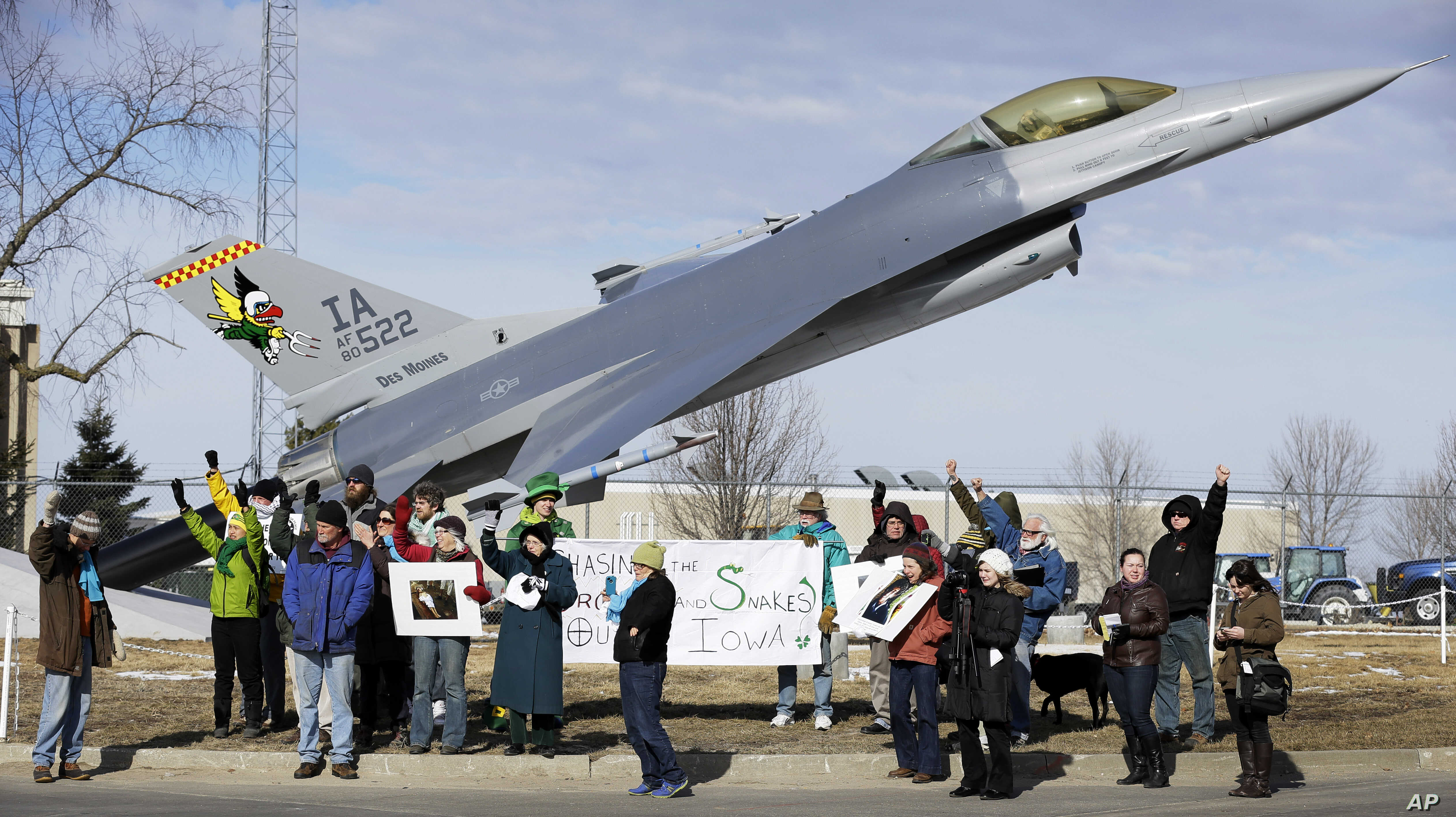FILE - Protesters rally outside the Iowa Air National Guard base in Des Moines, Iowa, March 17, 2014. Seven people who were rallying against the use of drones to carry out military strikes were arrested. On May 13 of that year, diplomats in Geneva be...