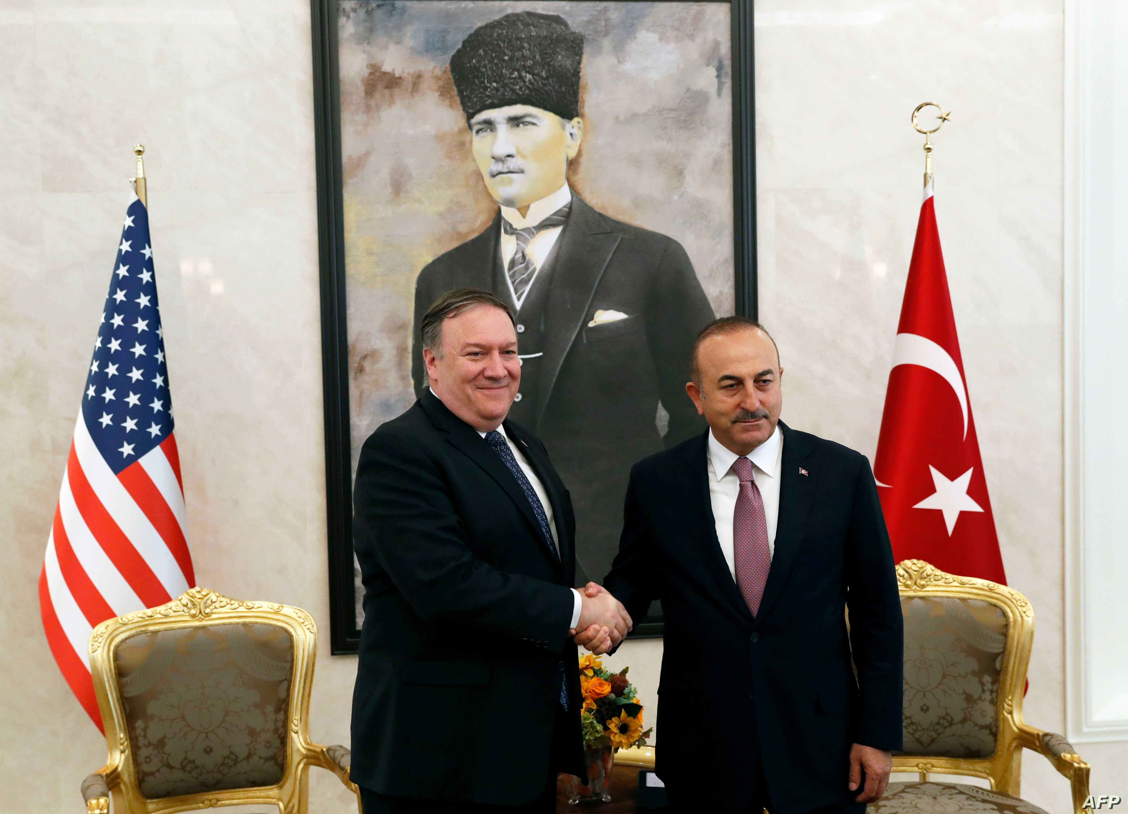 U.S. Secretary of State Mike Pompeo (L) meets with Turkish Foreign Minister Mevlut Cavusoglu in Ankara