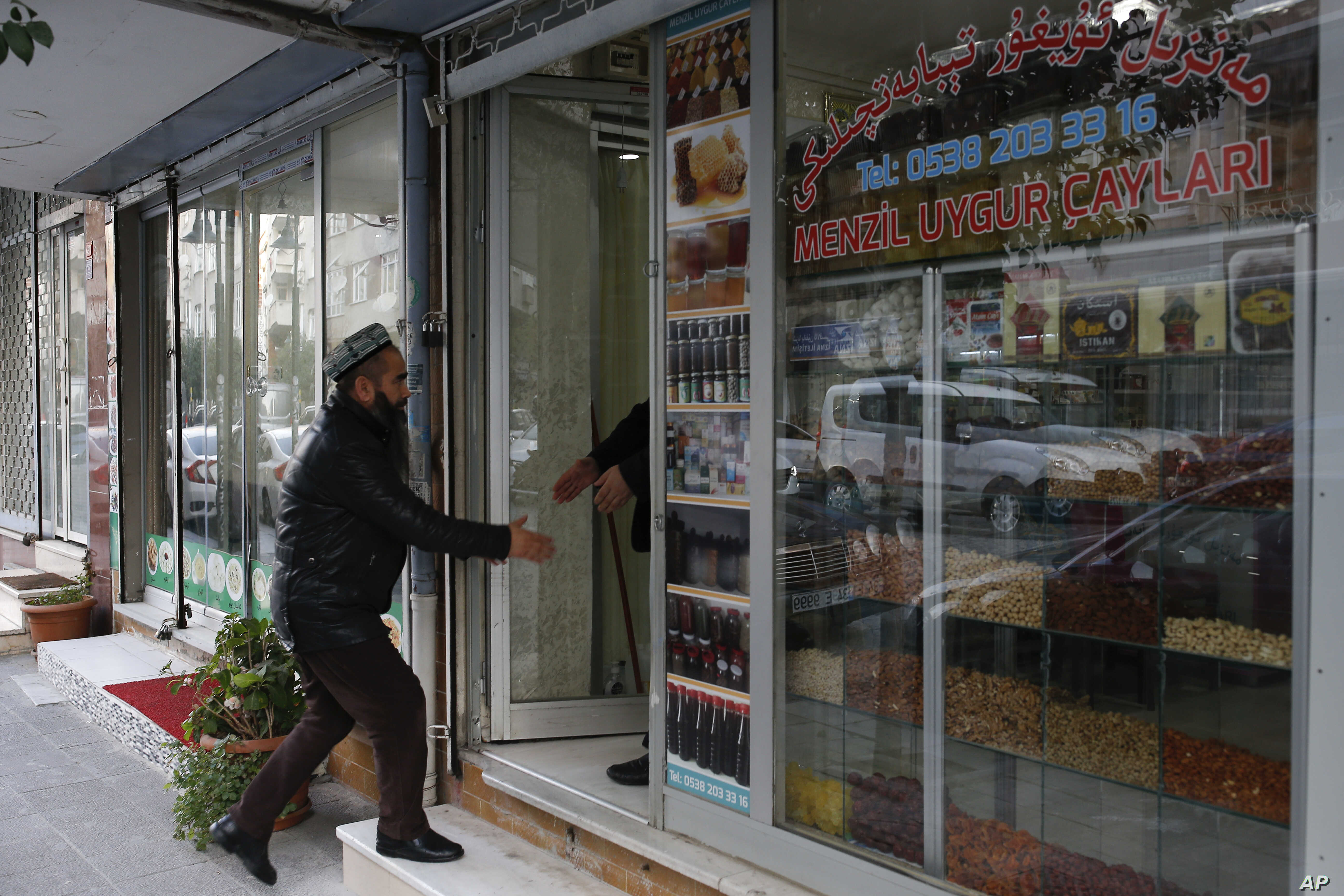 A man enters a shop in the Uighur immigrant neighborhood of Zeytinburnu, Turkey, Dec. 14, 2017.