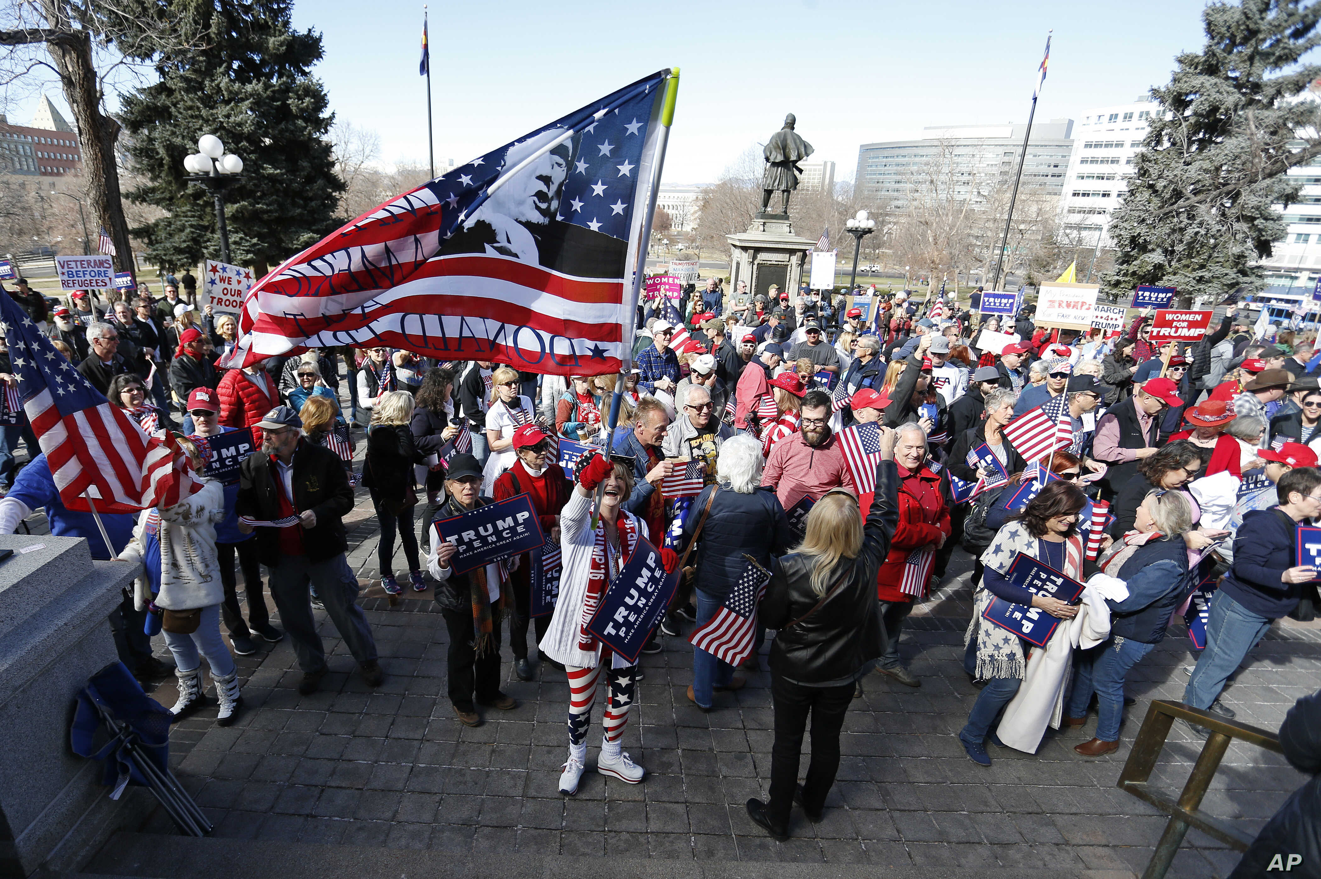 Supporters of President Donald Trump gather during a March 4 Trump rally on the state Capitol steps in Denver, March 4, 2017.