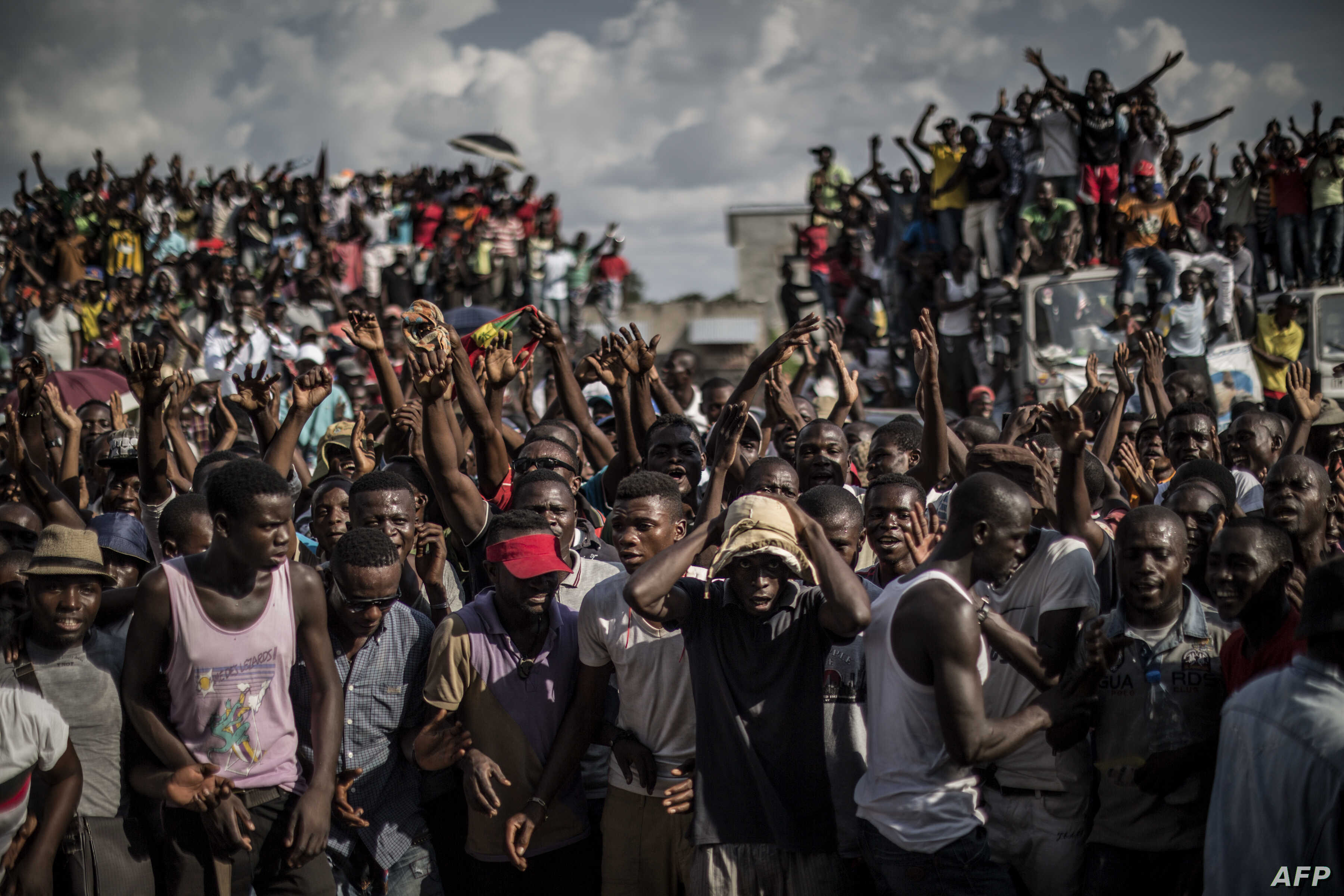 Supporters of Guy Brice Parfait Kolelas, the Interim President of the Congolese Movement for Democracy and Integral Development demonstrate at the candidate head quarter in Brazzaville on March 23, 2016.