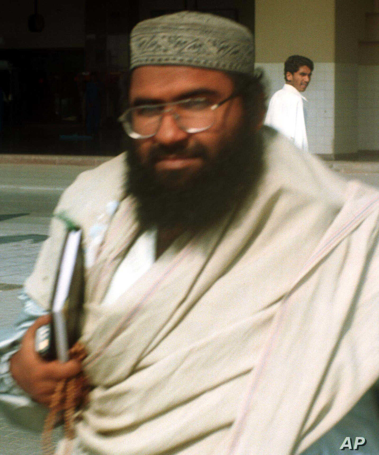 Maulana Masood Azhar, Muslim cleric and leader of the militant group fighting in Indian-held Kashmir against Indian forces arrives at Karachi airport, Jan. 22, 2000.