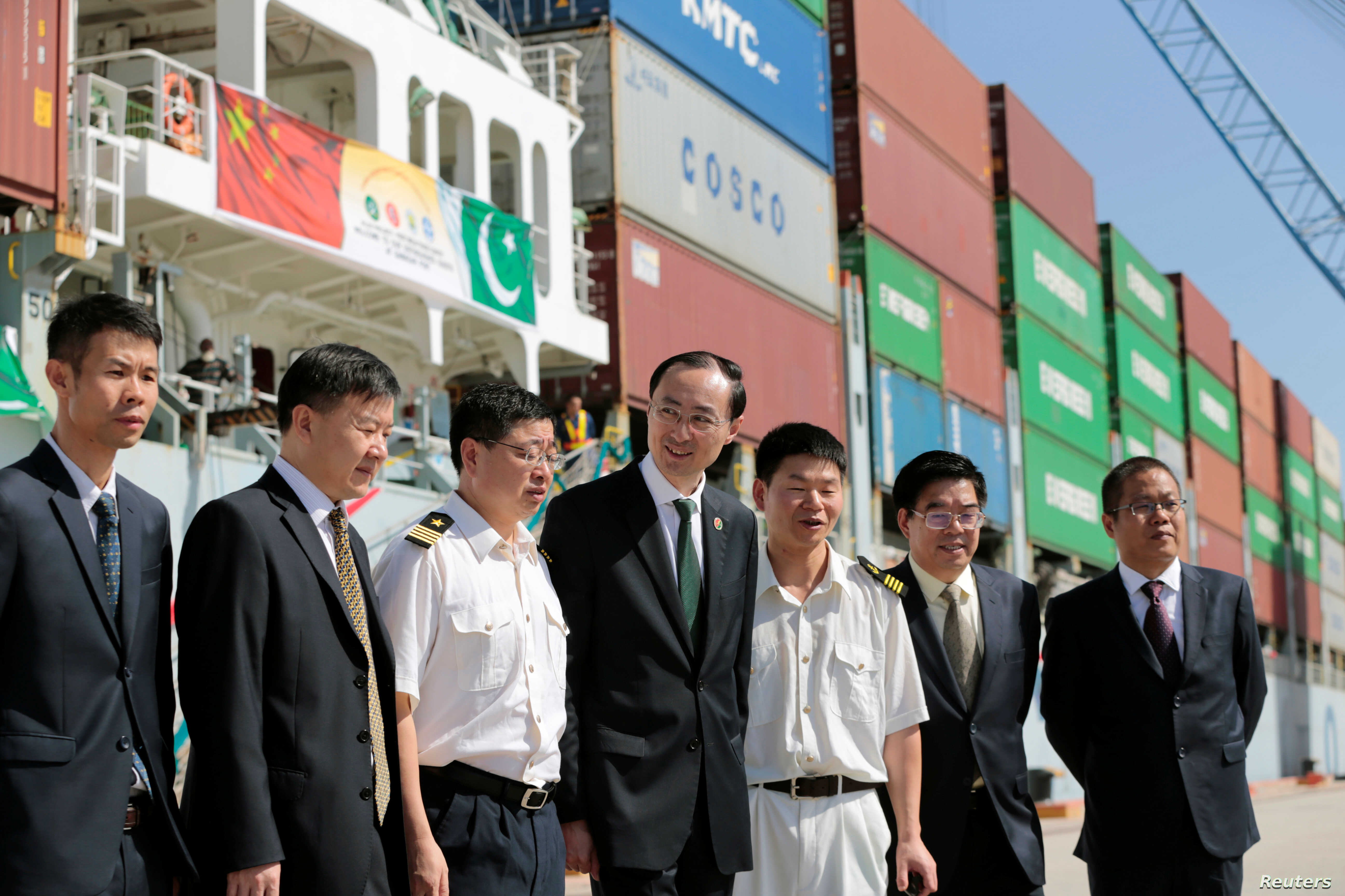 Chinese Ambassador to Pakistan, Sun Weidong (C), poses for pictures with members of his staff and crew of the first container ship to depart after the inauguration of the China Pakistan Economic Corridor port in Gwadar, Pakistan, Nov. 13,  2016.