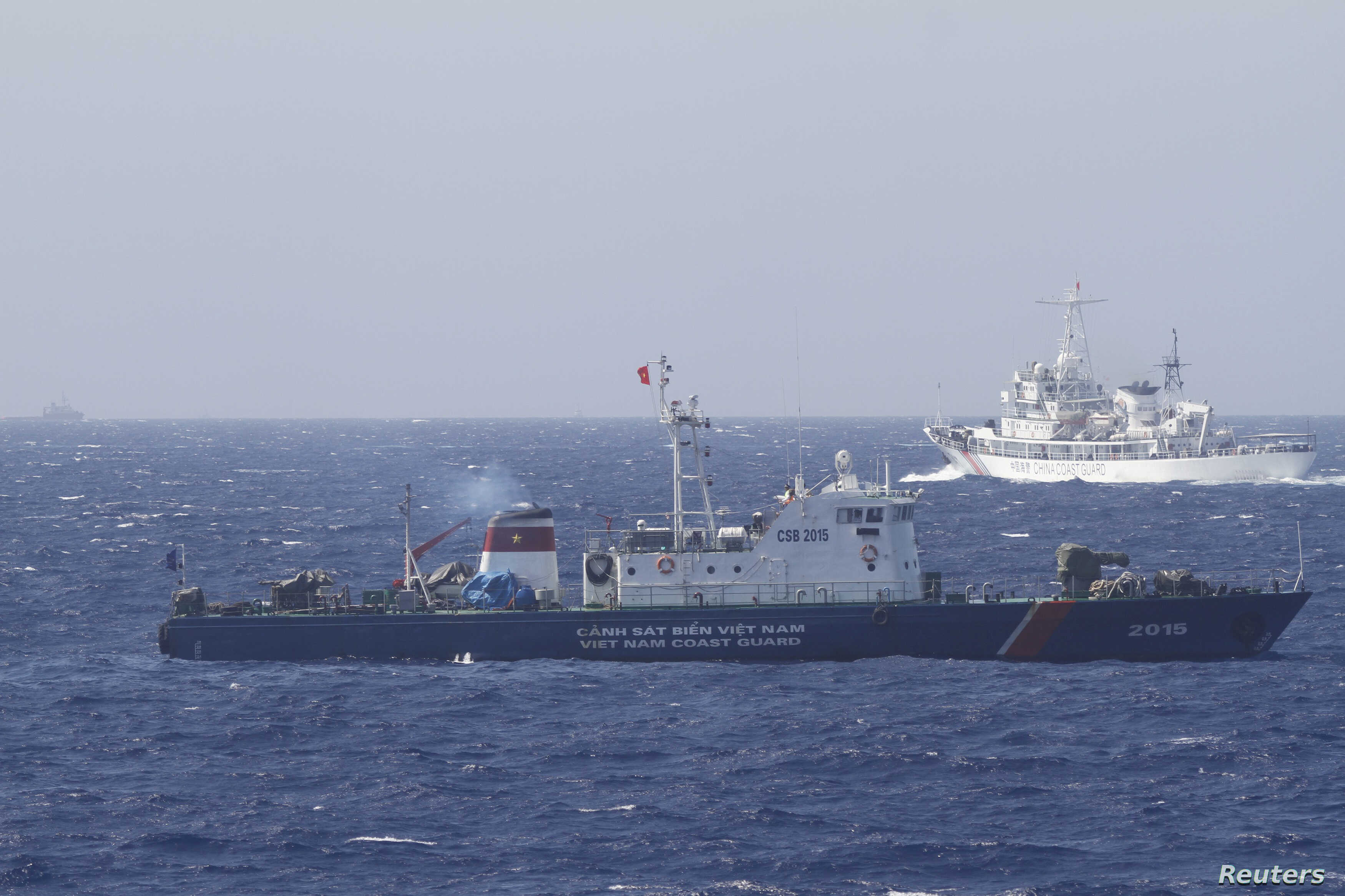 A ship (top) of Chinese Coast Guard is seen near a ship of Vietnam Marine Guard in the South China Sea, about 210 km (130 miles) off shore of Vietnam May 14, 2014. Vietnamese ships were followed by Chinese vessels as they neared China's oil rig in di...