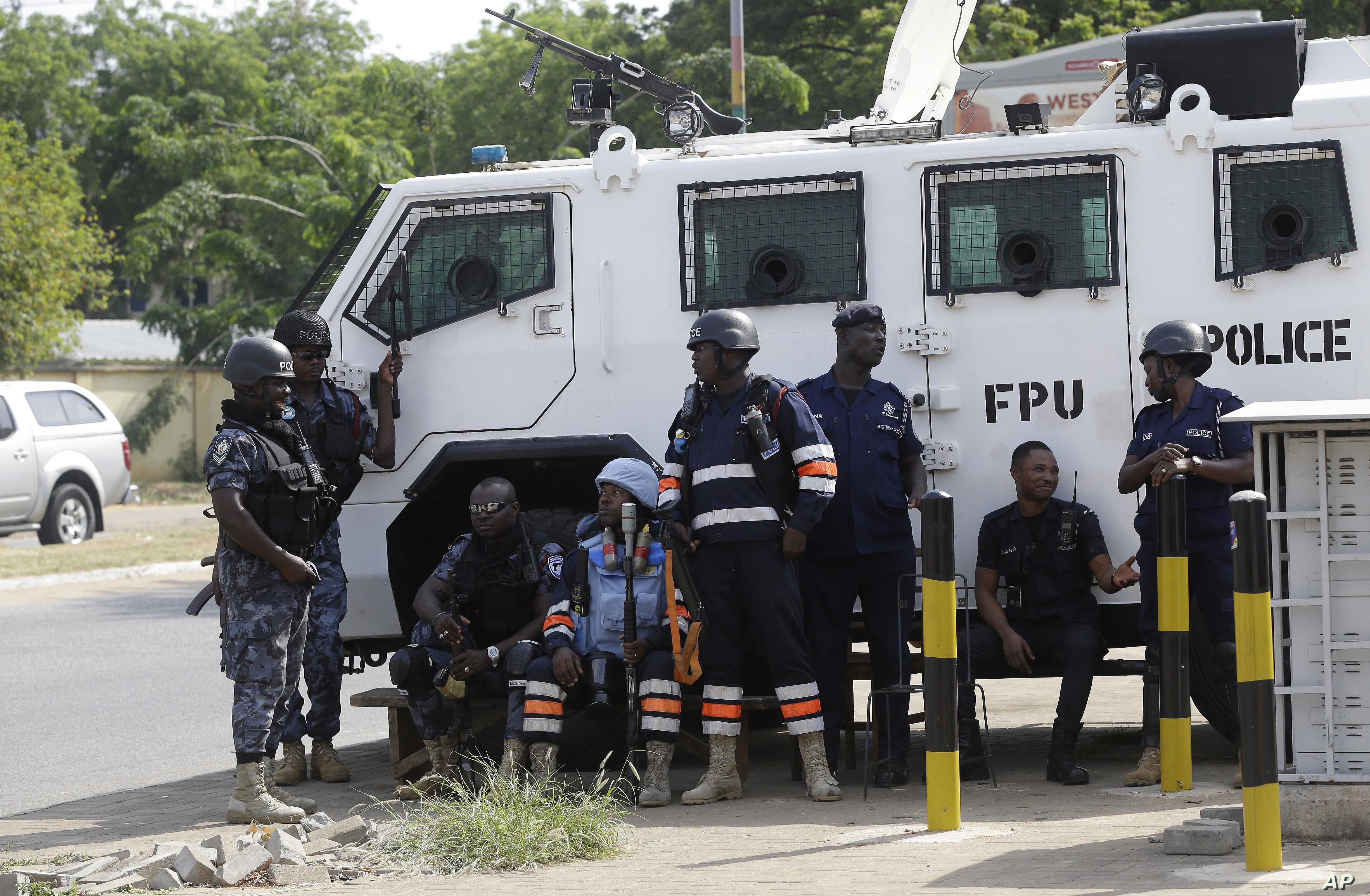 Police stand guard at the entrance of the Ghana electoral commission office in Accra, Ghana, Dec. 9, 2016.