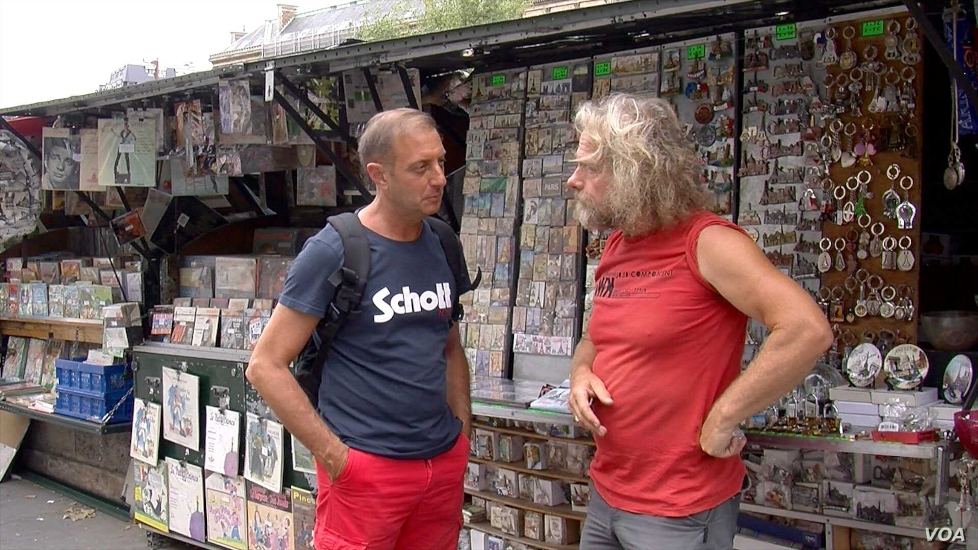 Bouquiniste Francis Robert, right, is against the UNESCO bid, fearing it will end his ability to sell the souvenirs he says he needs to survive.