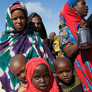 Women and children queue to receive food at a World Food Program distribution center in Mogadishu.