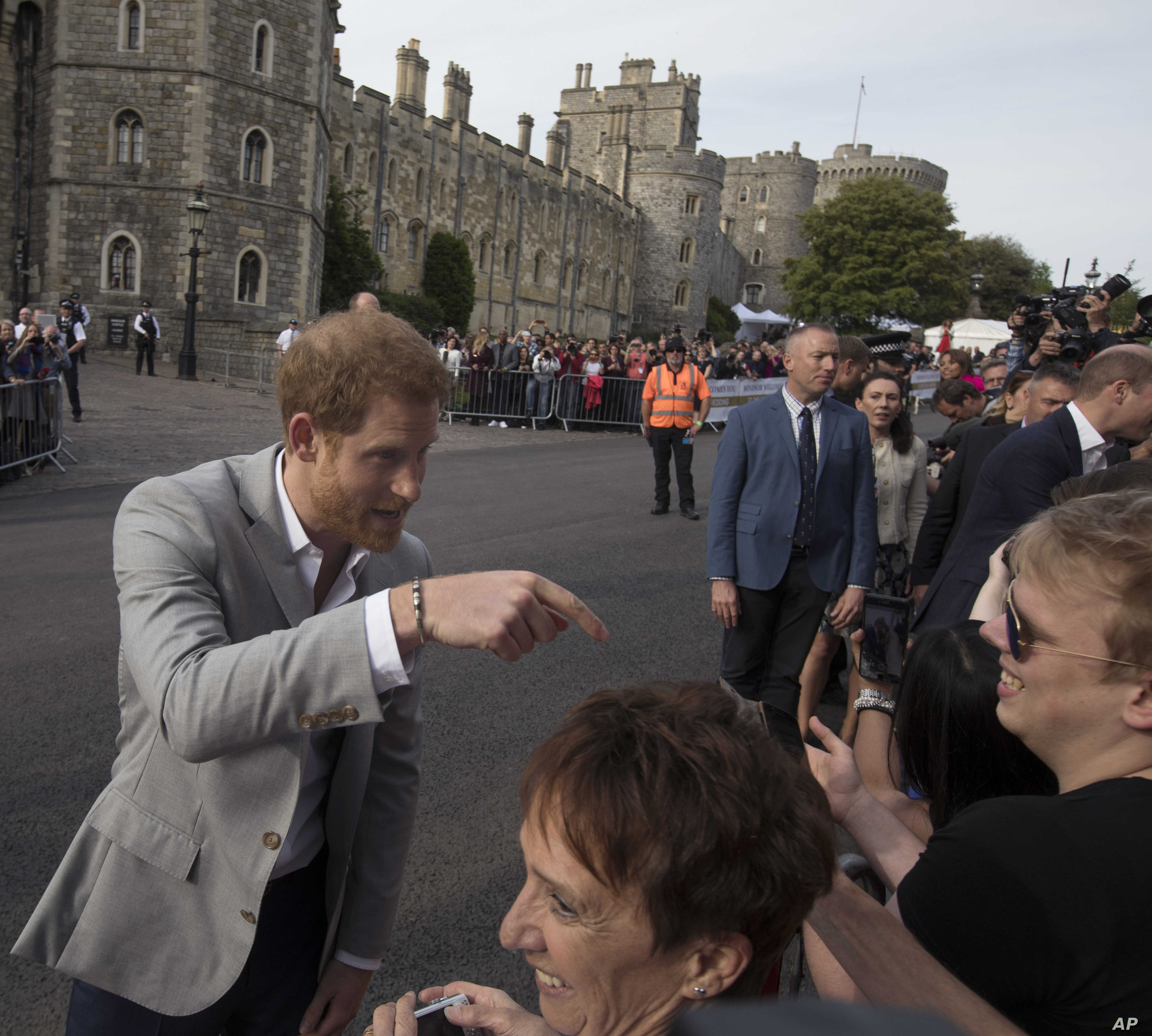 Britain's Prince Harry, left, and Prince William greet well-wishers outside Windsor castle, in Windsor, England, May 18, 2018, ahead of Prince Harry's wedding to Meghan Markle on May 19.