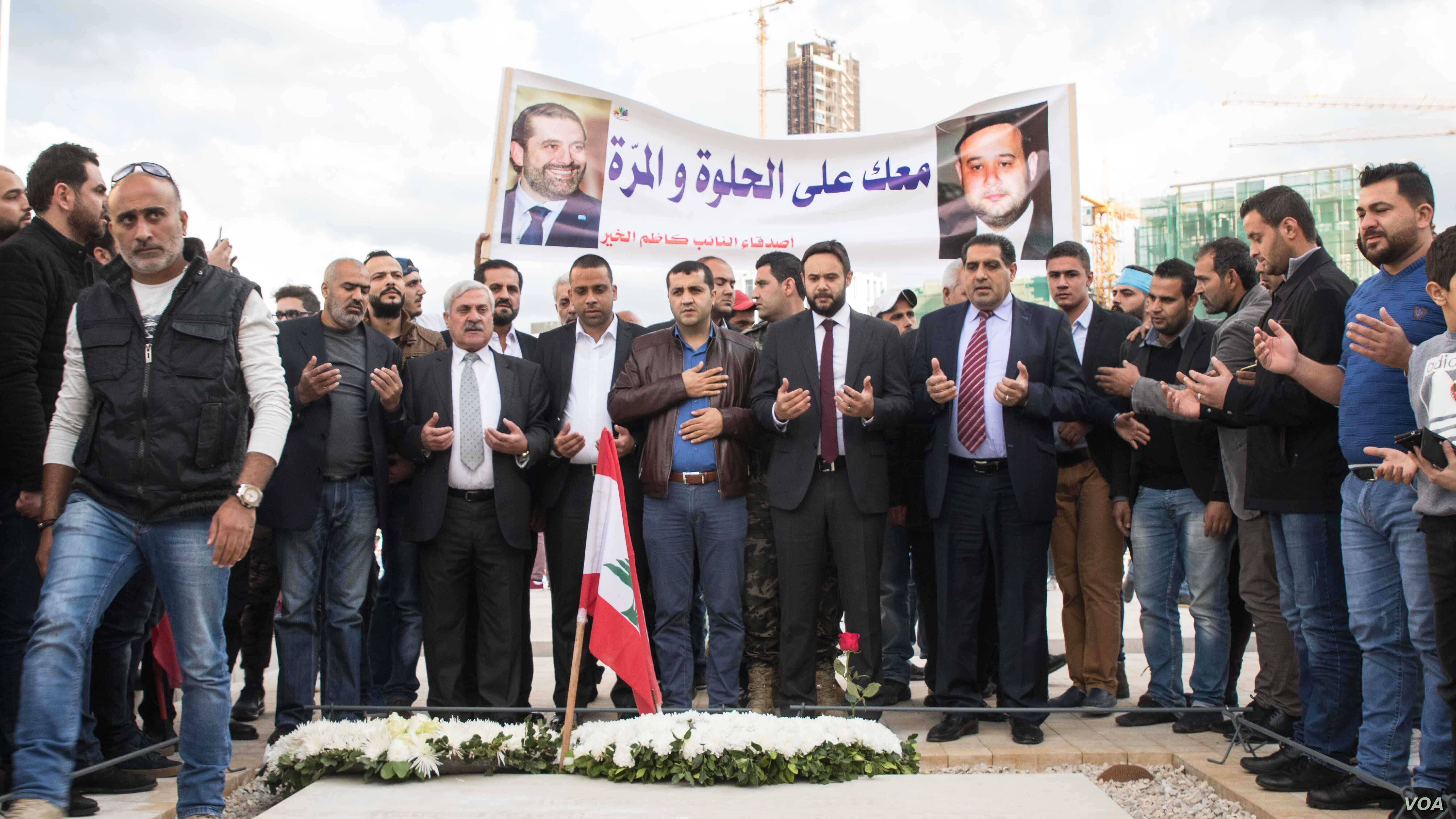Supporters of Prime Minister Saad Hariri stand in front of the grave his father, Rafik, in Beirut, Lebanon, Nov. 22, 2017. (John Owens for VOA)