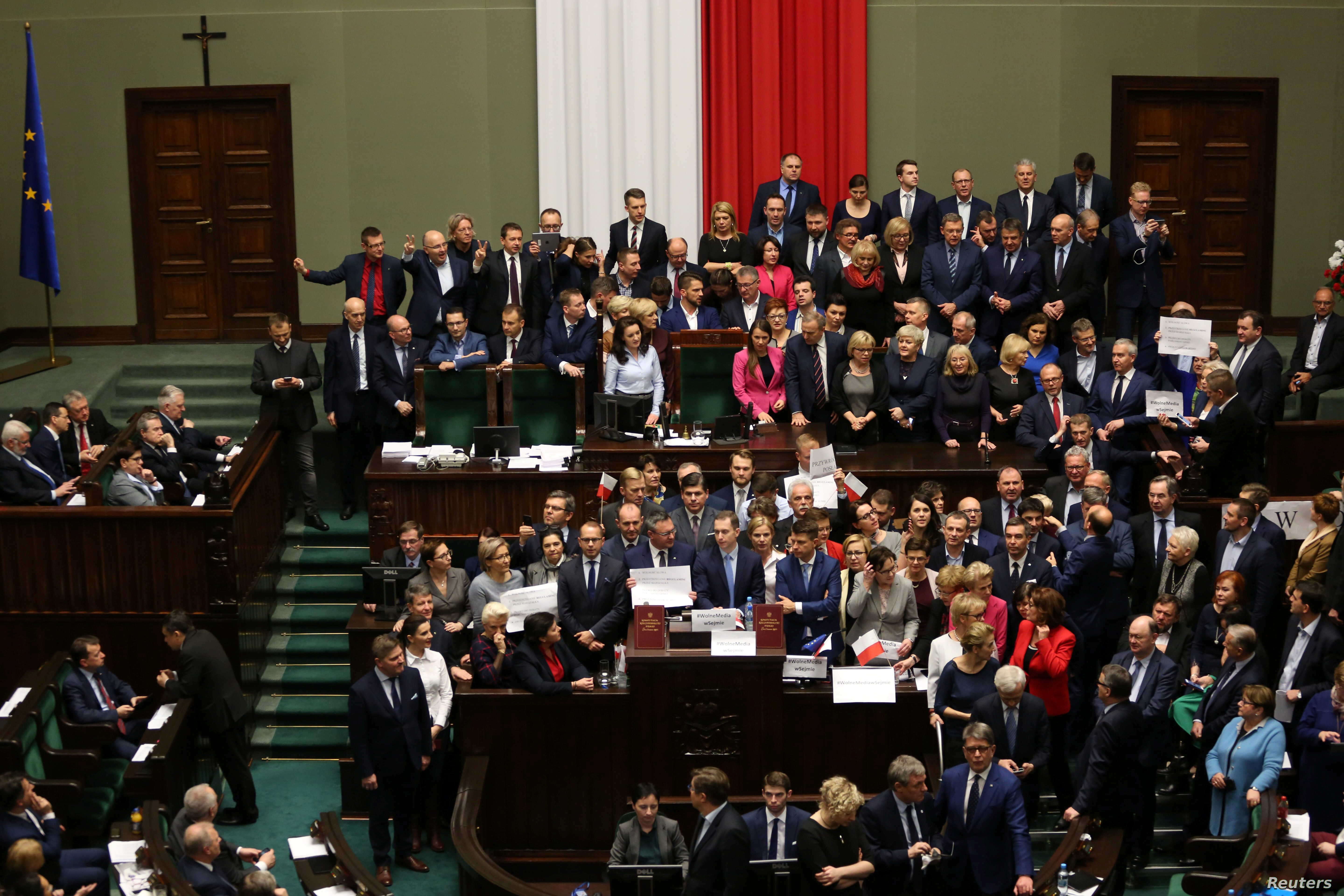 Polish opposition parliamentarians protest against the rules proposed by the head office of the lower house of parliament that would ban all recording of parliamentary sessions except by five selected television stations and limits the number of jour...